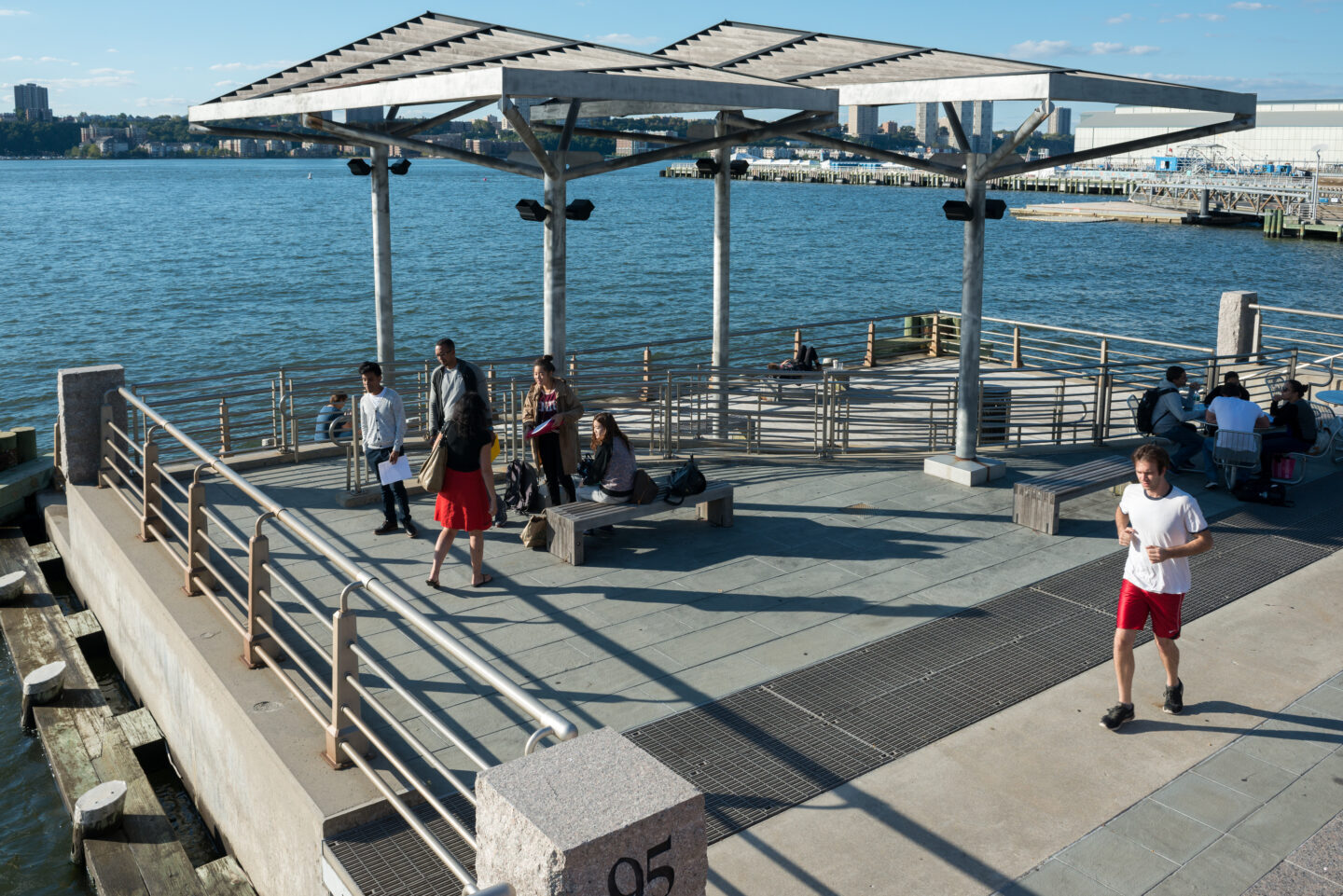 Pier 95 with park visitors and joggers