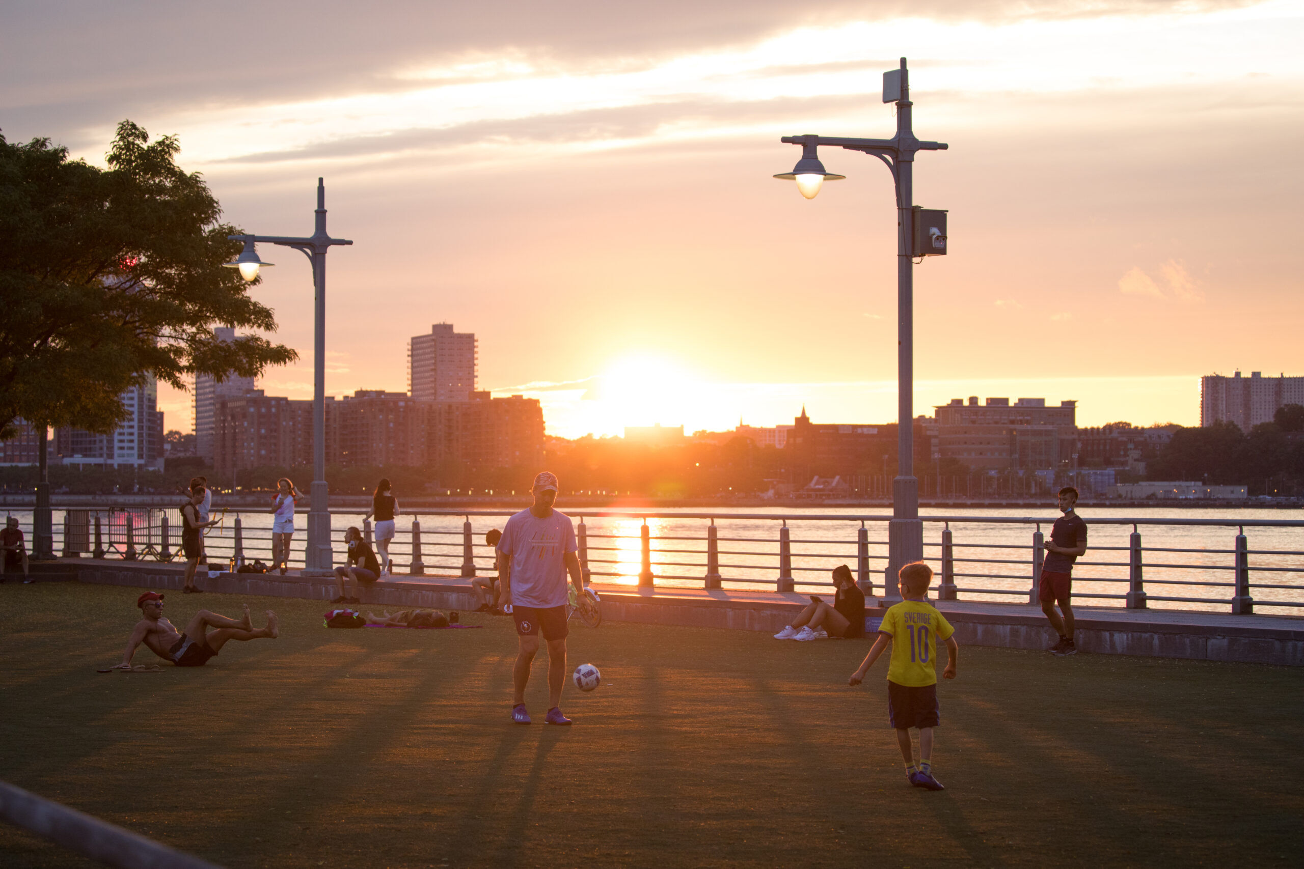 Sunset at Pier 46 as soccer players practice on the field