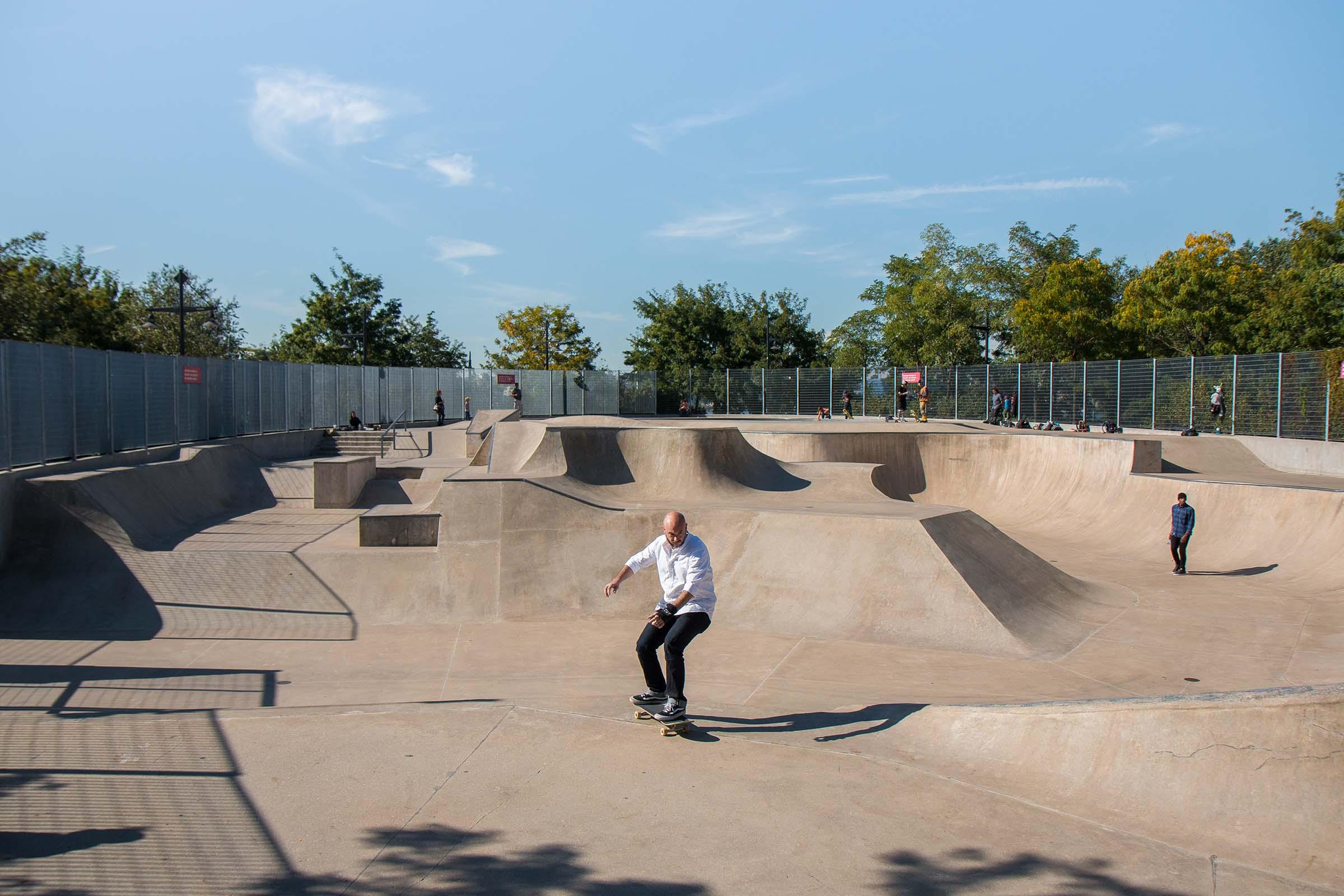 A skateboarder preps the next curve at the Pier 62 skatepark