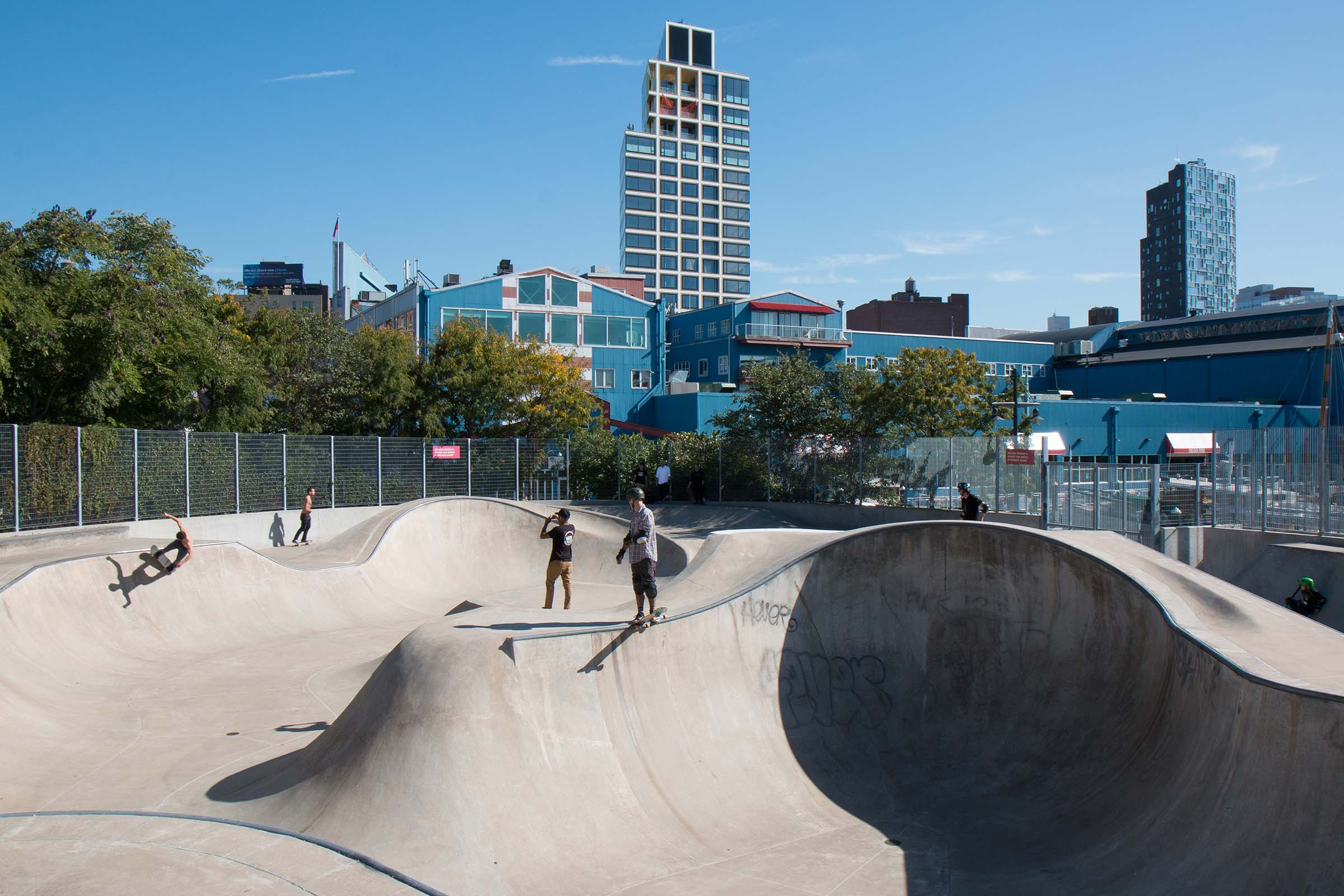Two skateboarders ready to head down a hill at the skatepark at Pier 62