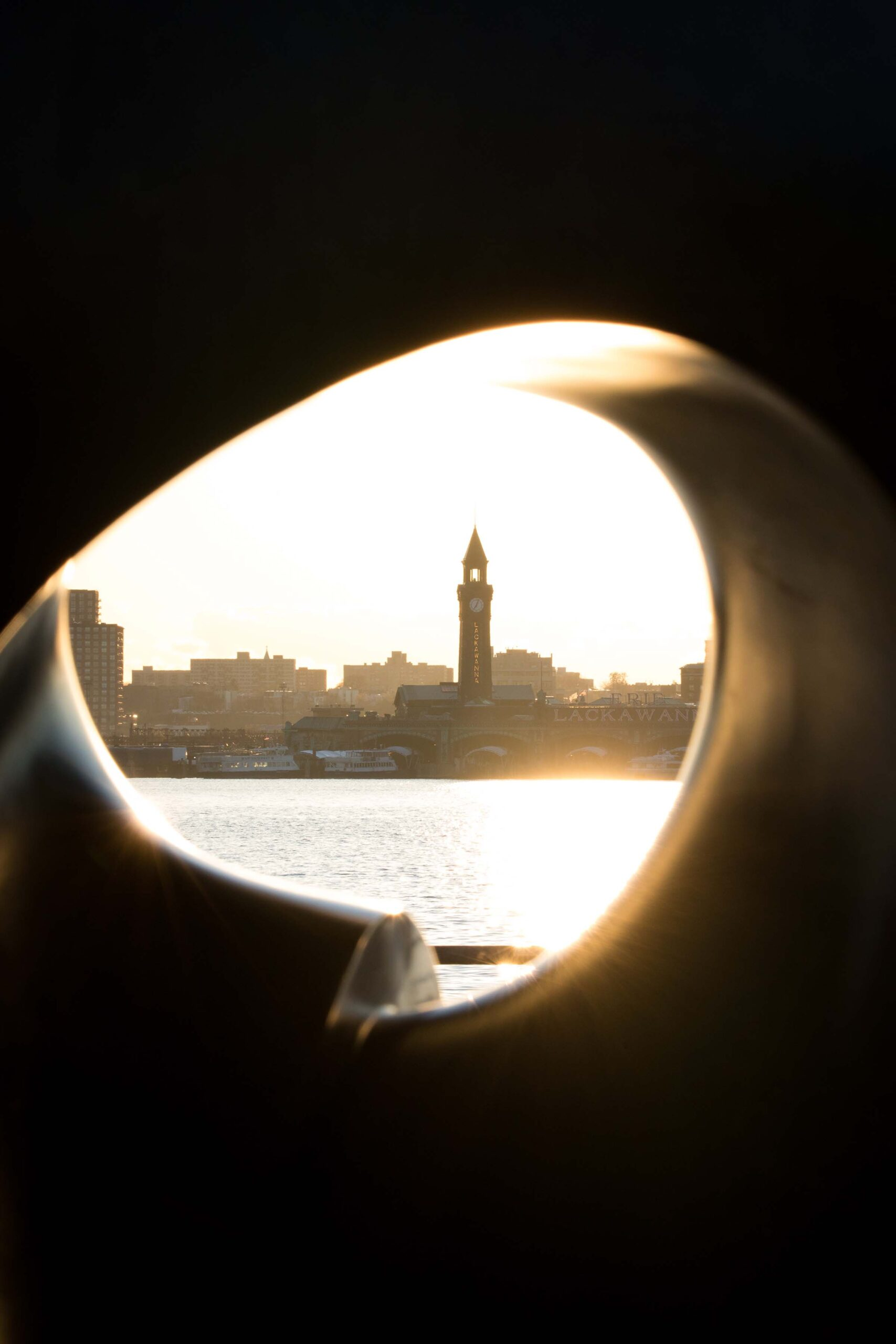Through the Apple's core you can see the tower across the Hudson River in New Jersey