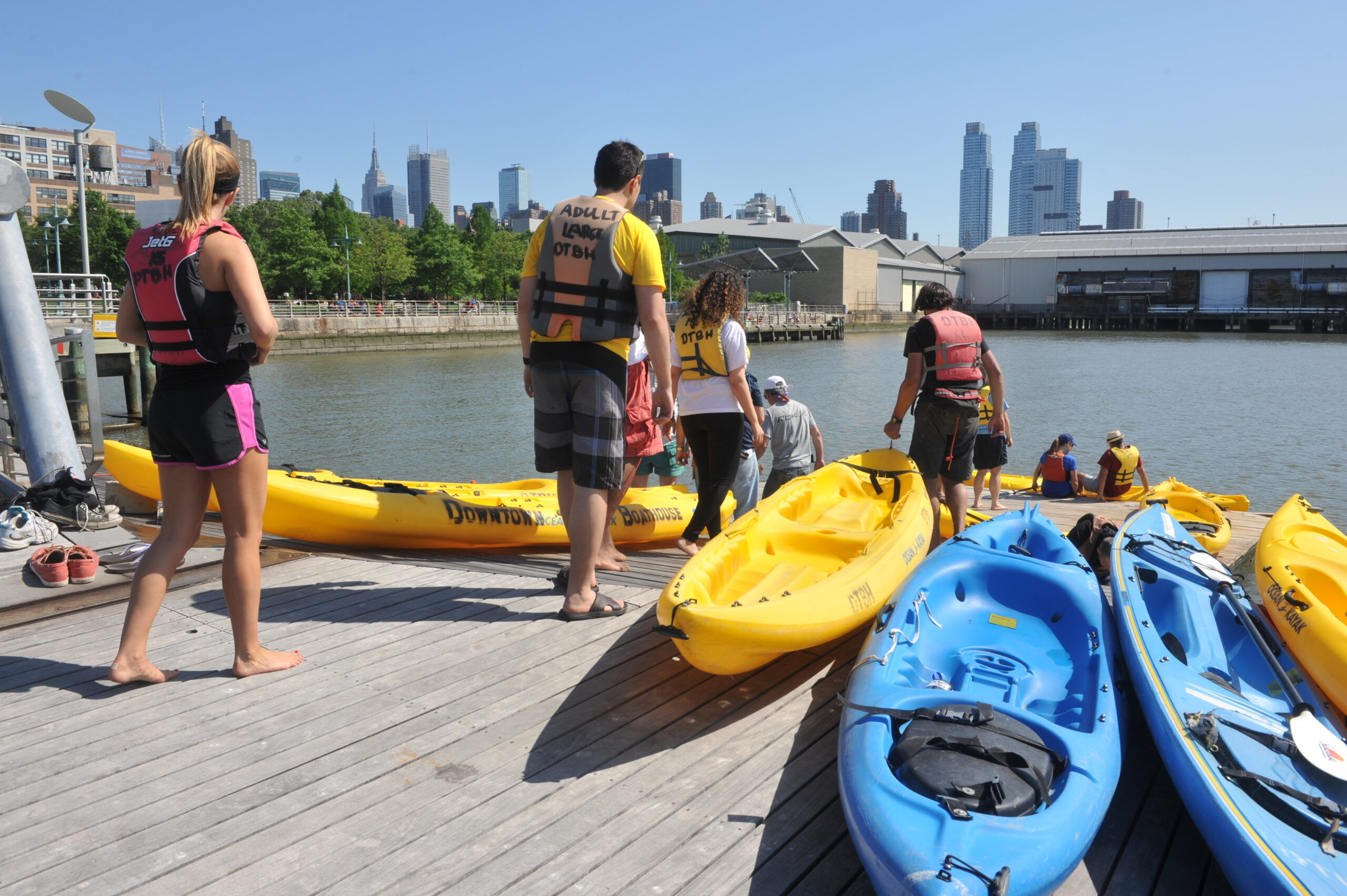Kayakers prepare to head out on the river