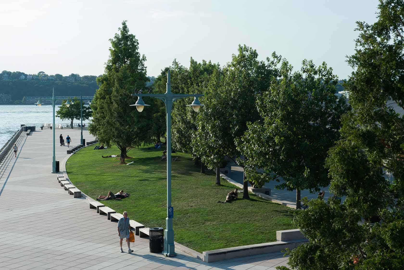 The Pier 84 lawn with Park visitors sunbathing