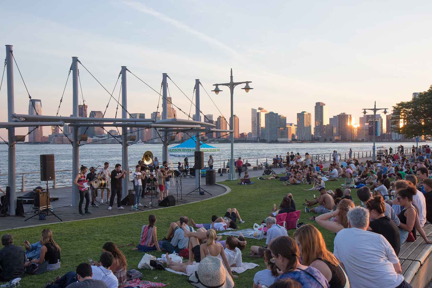 A brass band plays for a crowd at Pier 45