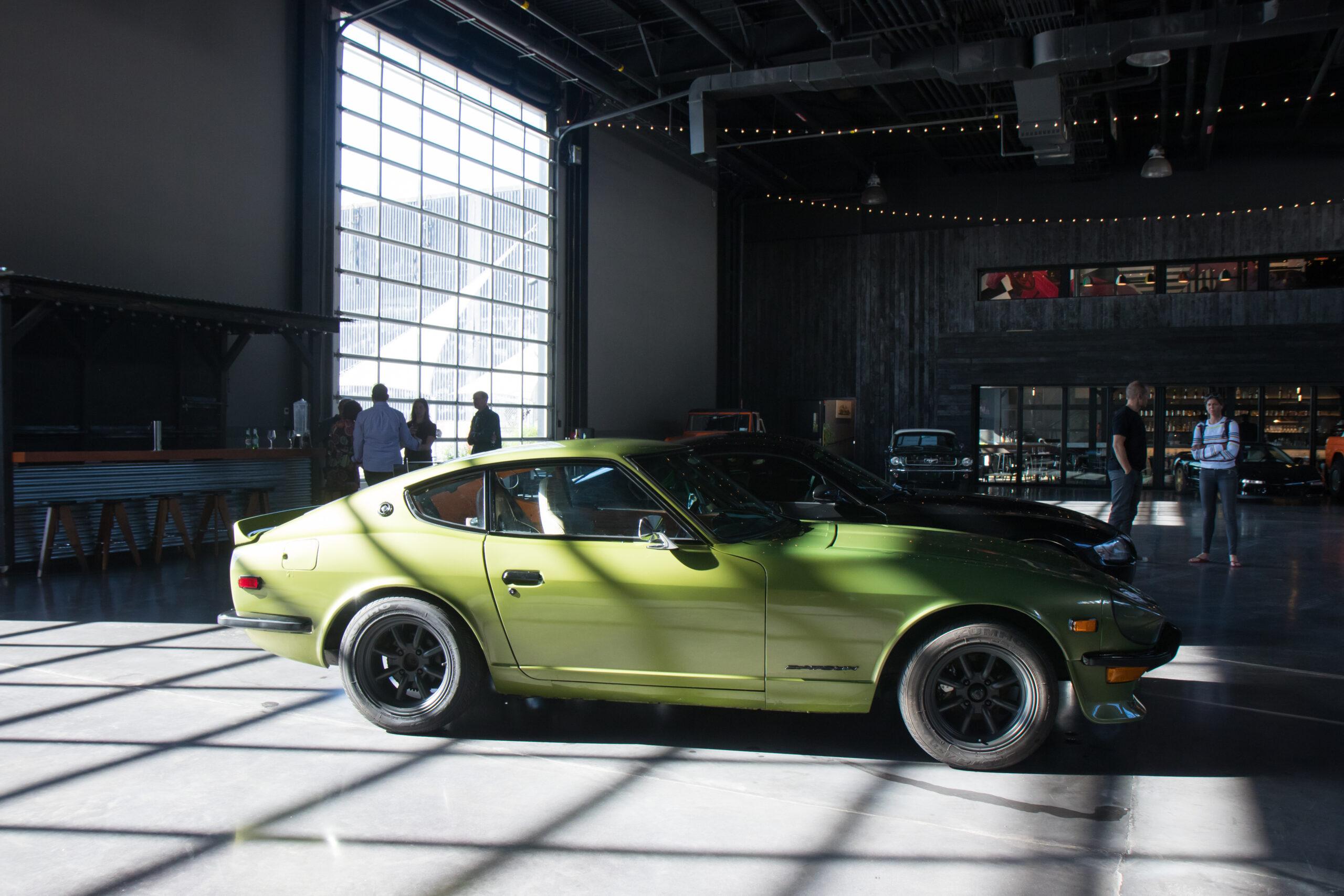 A green sports car at Classic Car Club