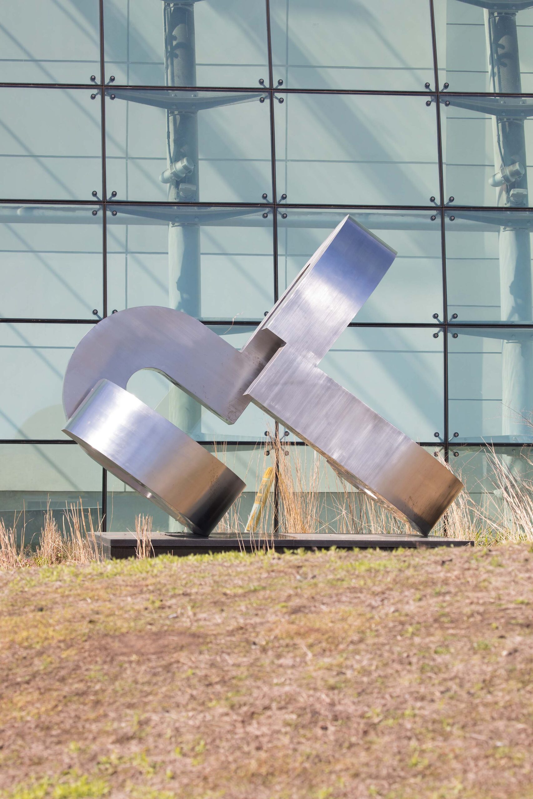 The art piece SENES sits on Pier 79, a steel structure with round edges connected to each other
