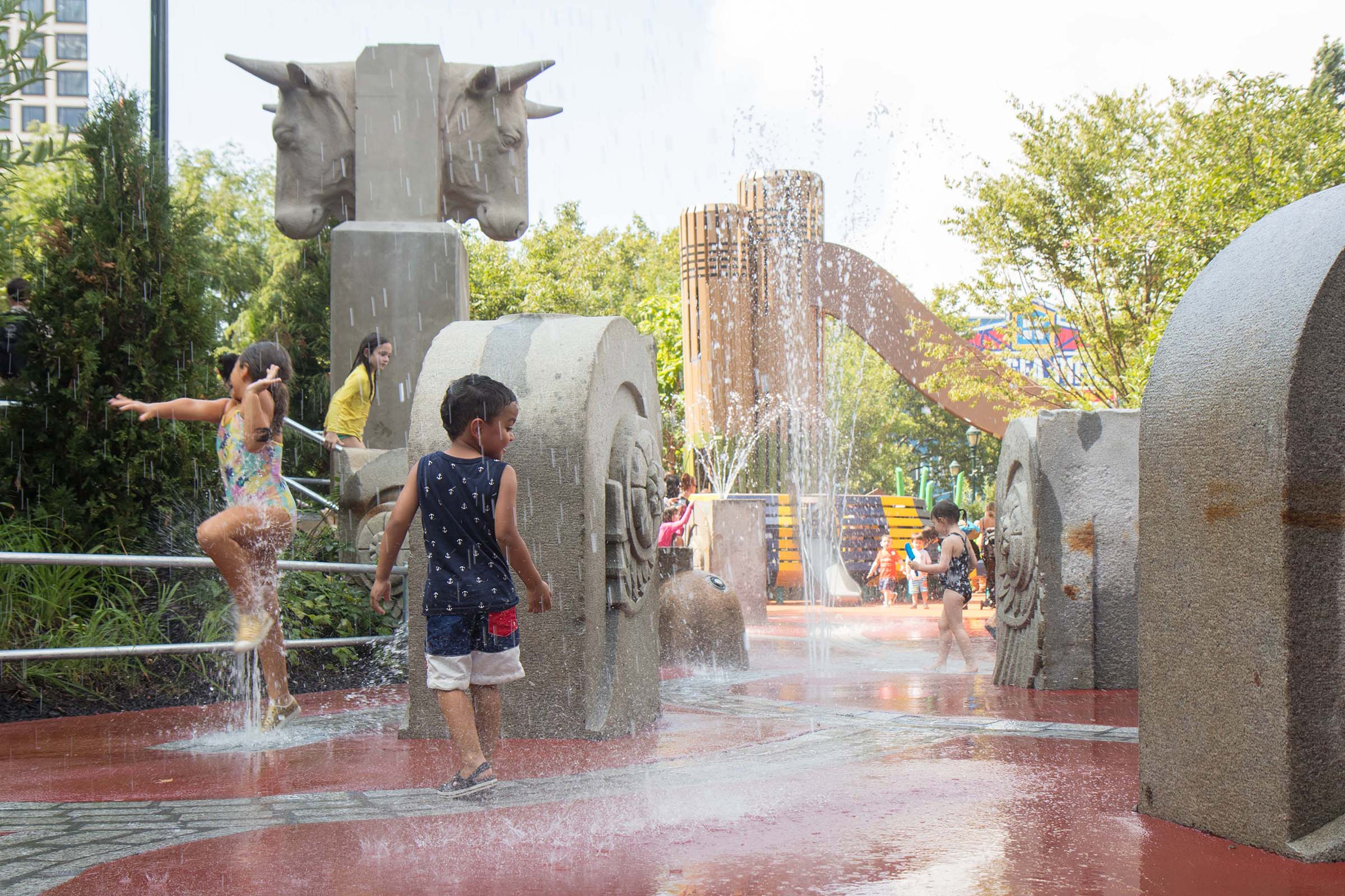 Kids play in the water area at Chelsea Waterside Playground