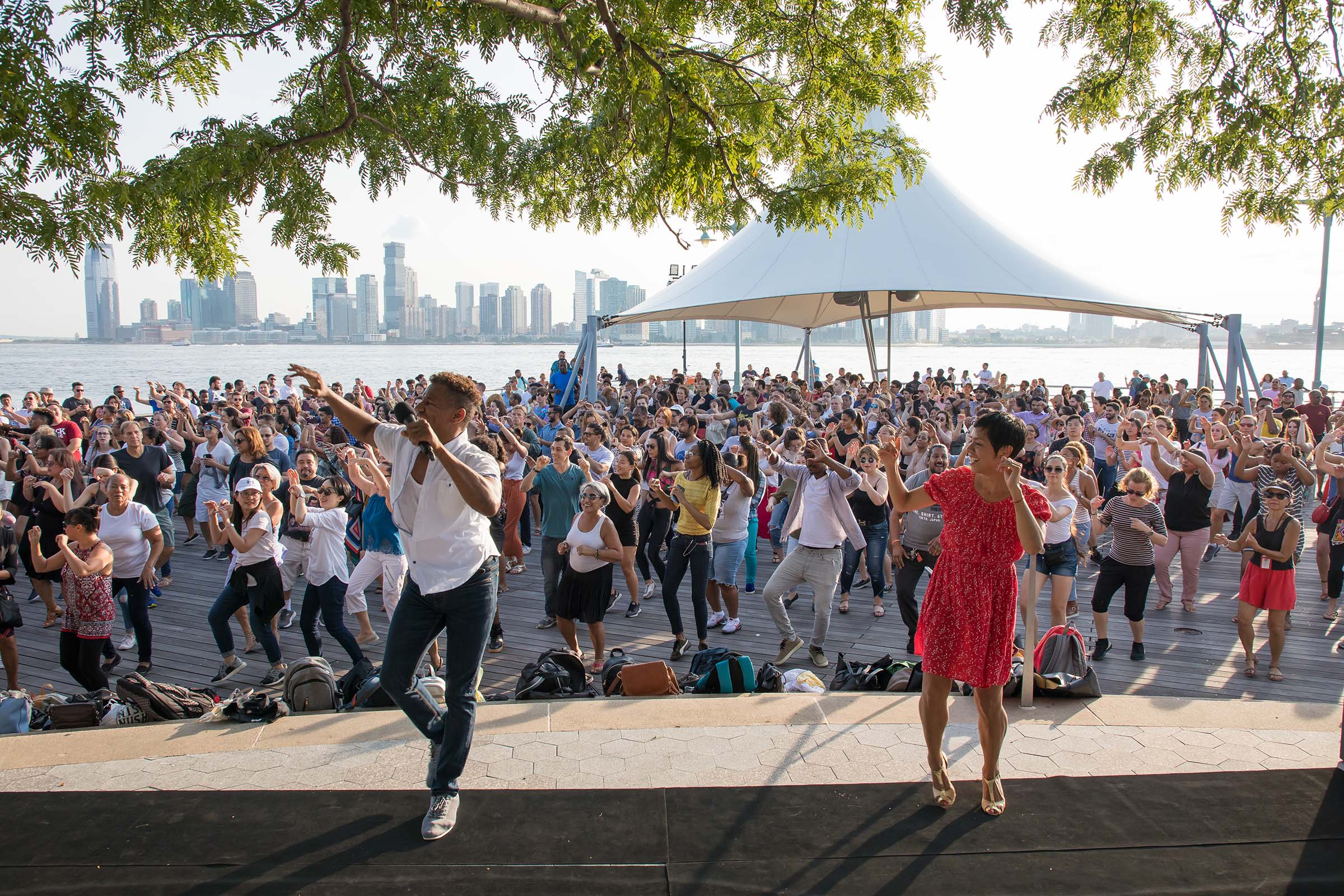 Talia teaches a group of Park visitors how to salsa at Pier 45