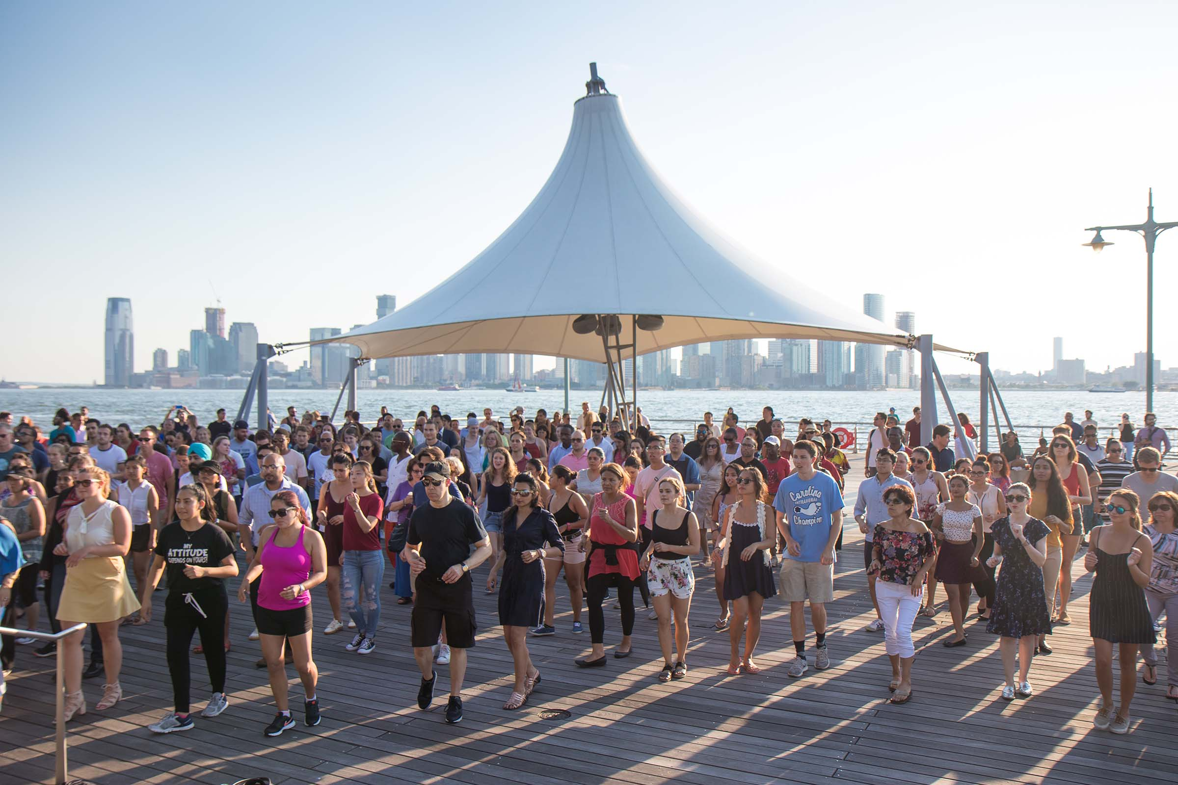 Under the canapé at Pier 45, Park visitors learn how to salsa dance