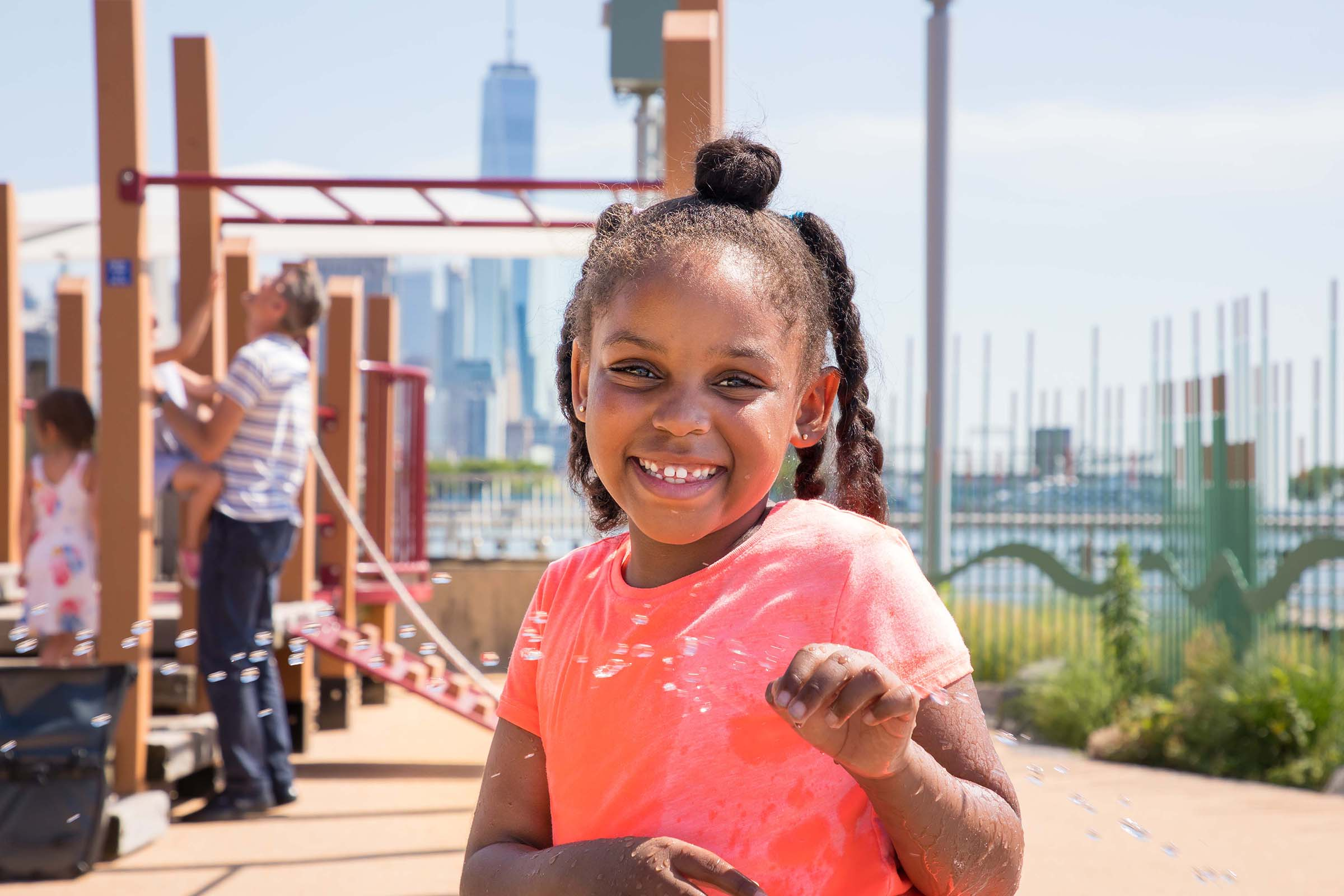 A young girl enjoying bubbles at Pier 51's playground