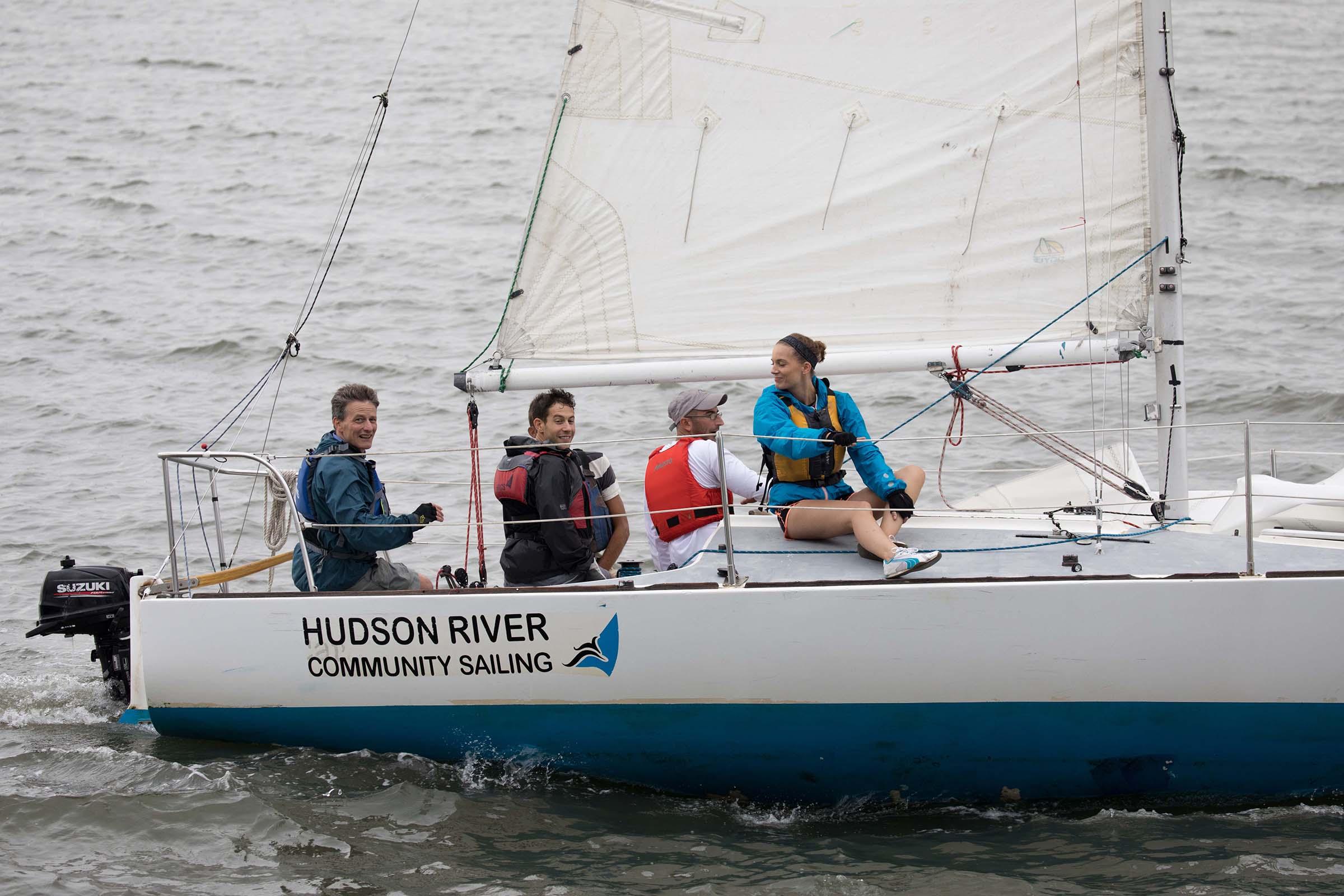 Close up of sailers enjoying a ride at the Hudson River Community Sailing program