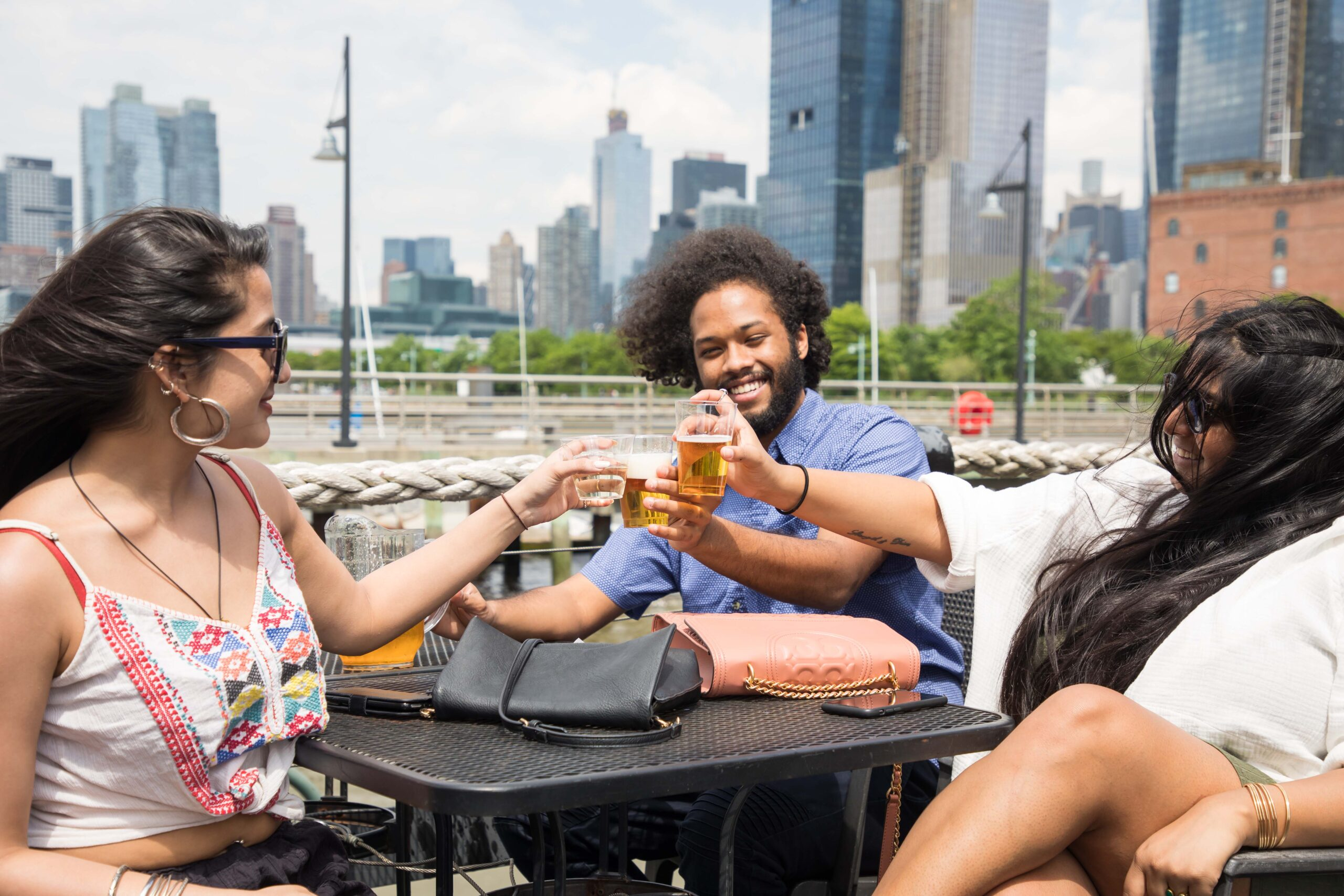 Park visitors enjoy a drink on the Frying Pan, a historic vessel on Pier 66a