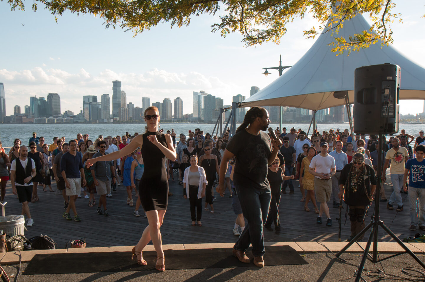 Sunset Salsa with Talia leading the large group on Pier 45