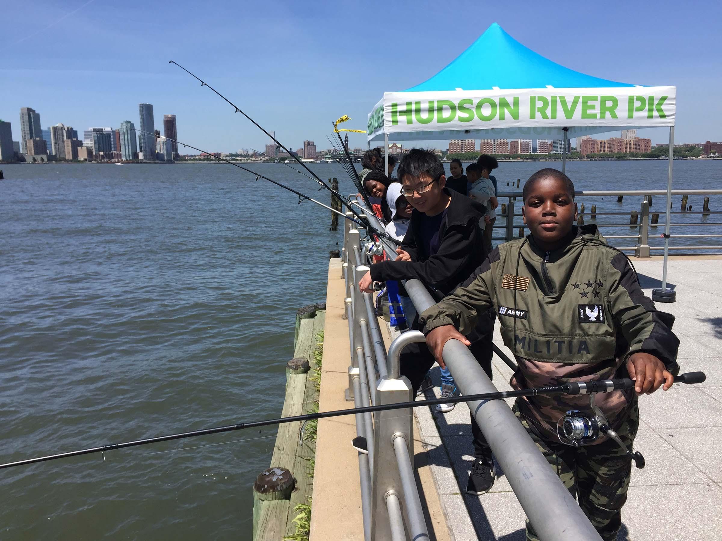 Kids enjoying fishing in the Hudson River