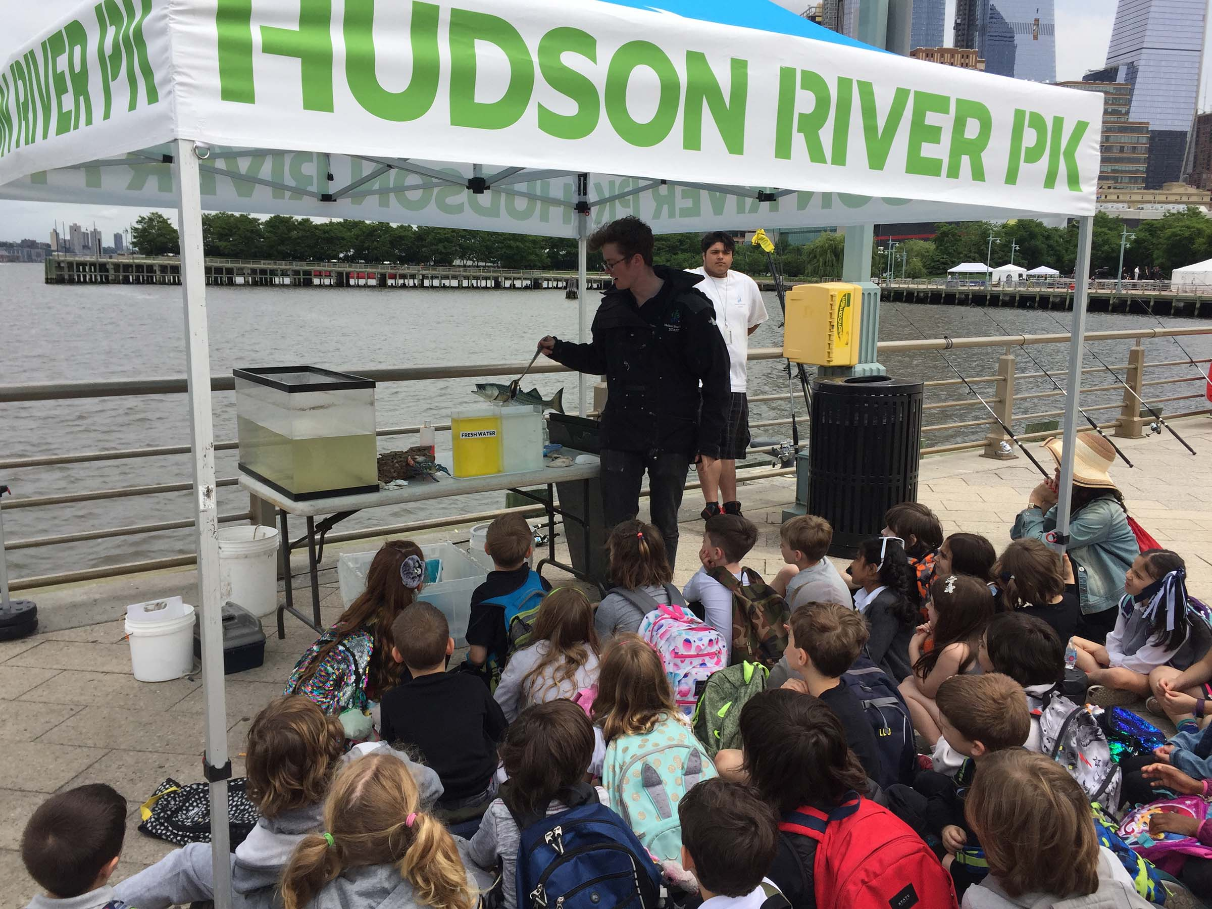A Park educator teaches students about fish in the Hudson River