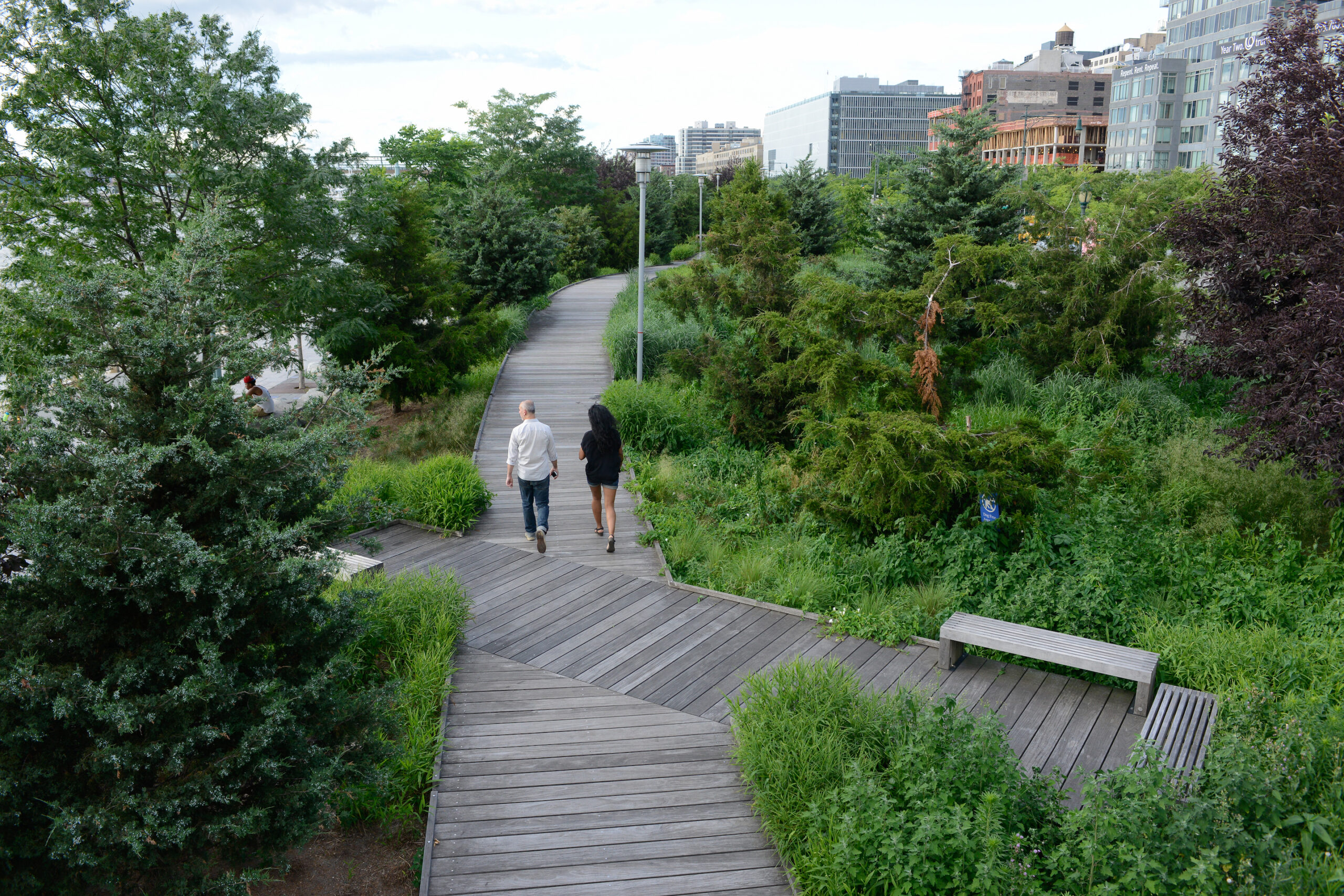 The tribeca boardwalk and two park visitors walking