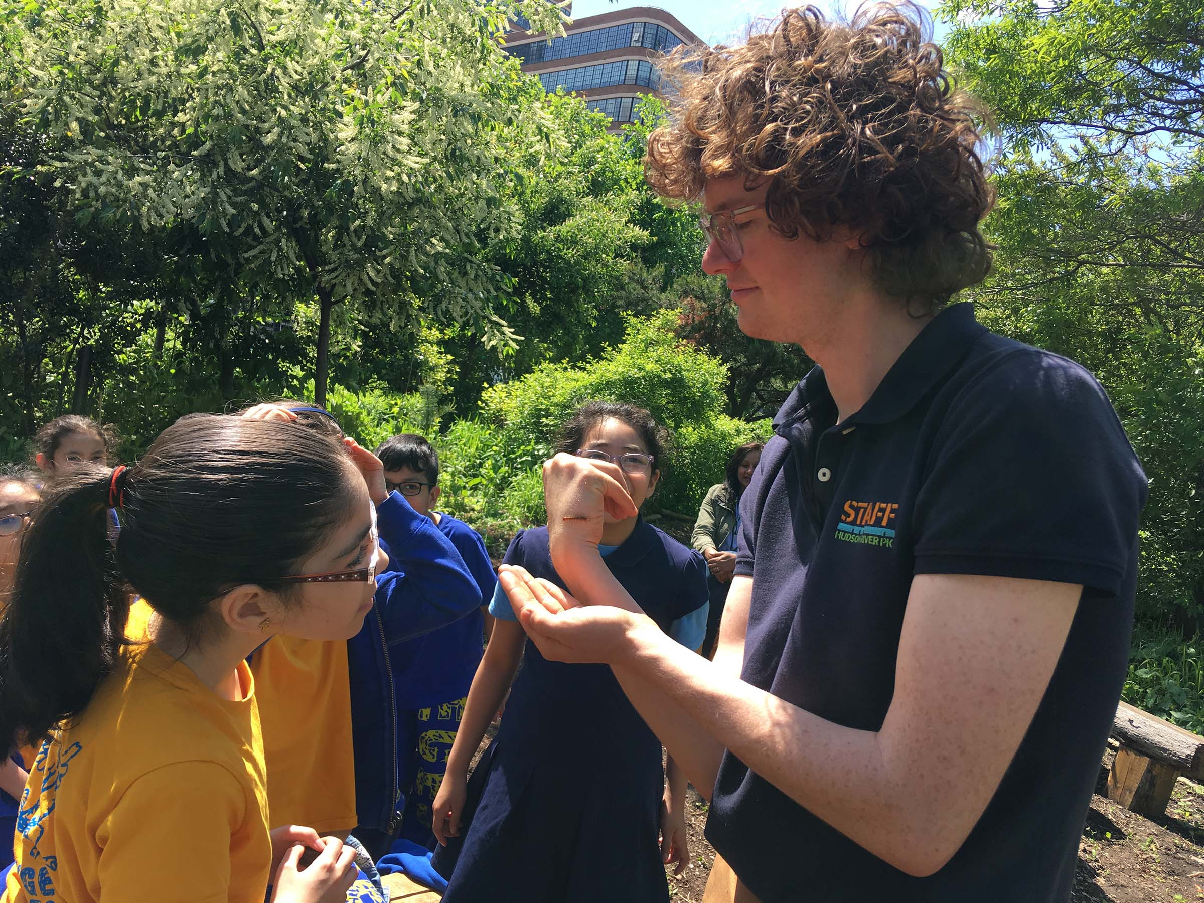 A Park educator shows an insect that landed on his hand