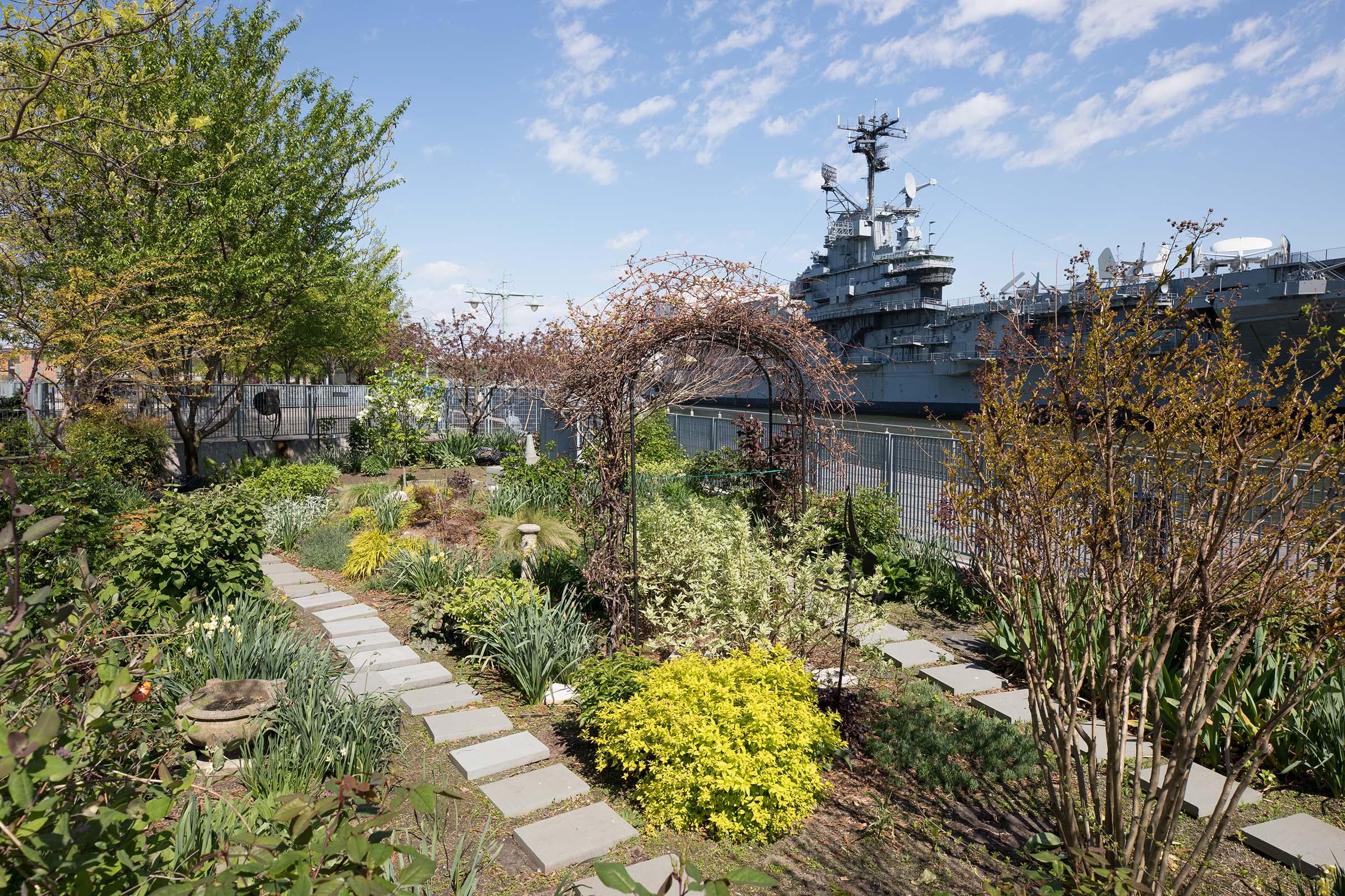 An oval trellis is a centerpiece in the community garden