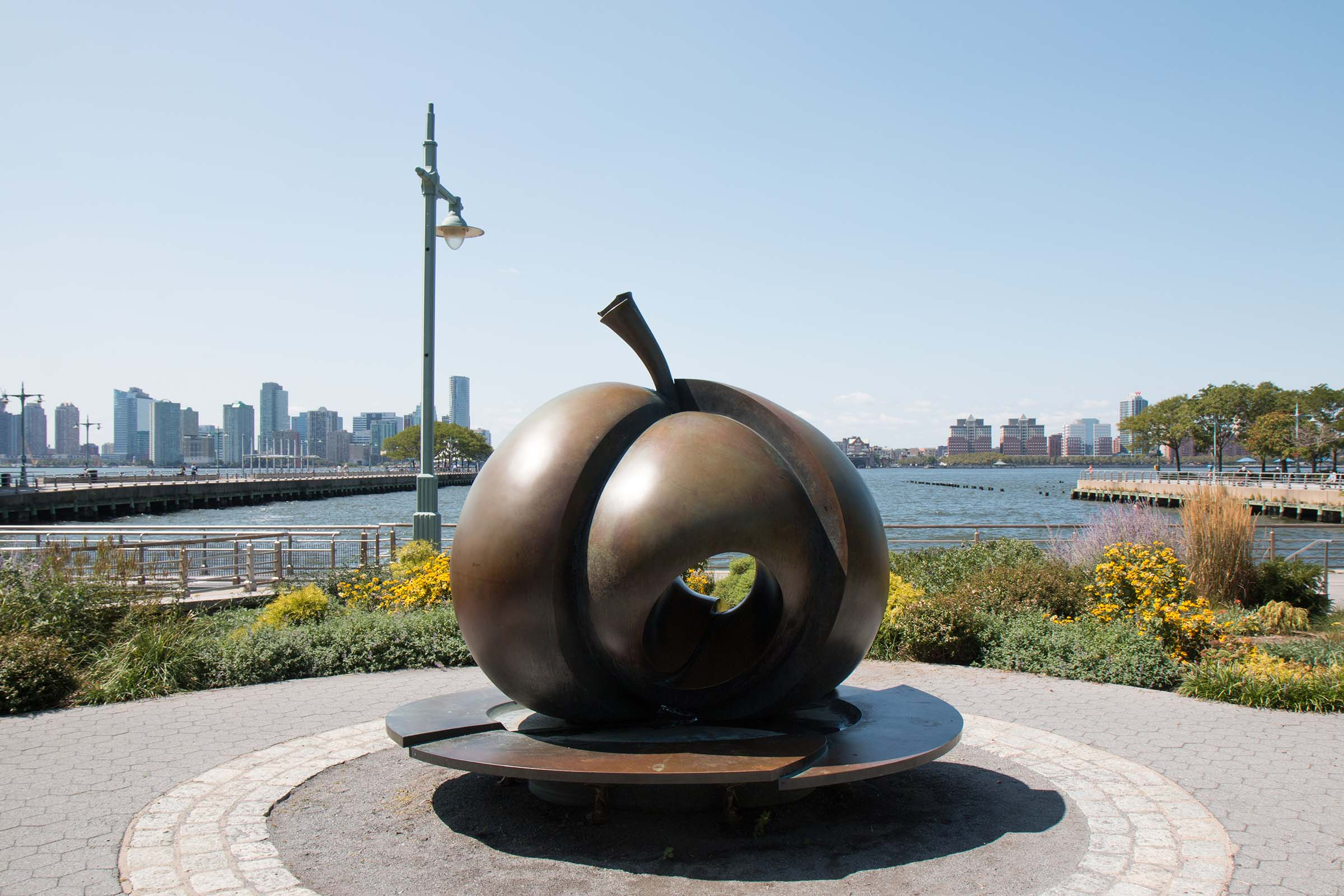 The bronze statue of an Apple sits in the center of the Apple Garden