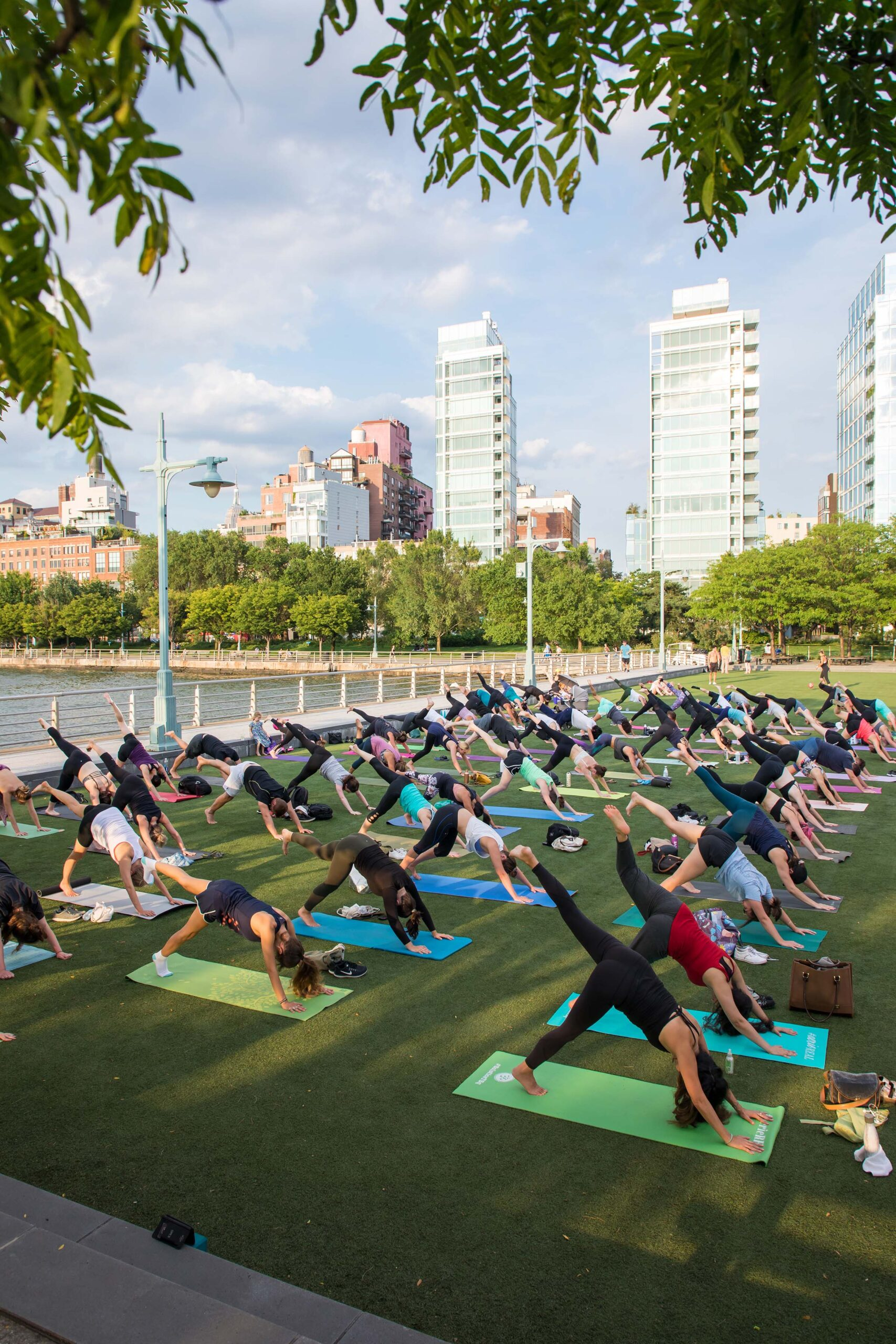 During a yoga class at Pier 46, the participants raise their legs in the air and press the ground