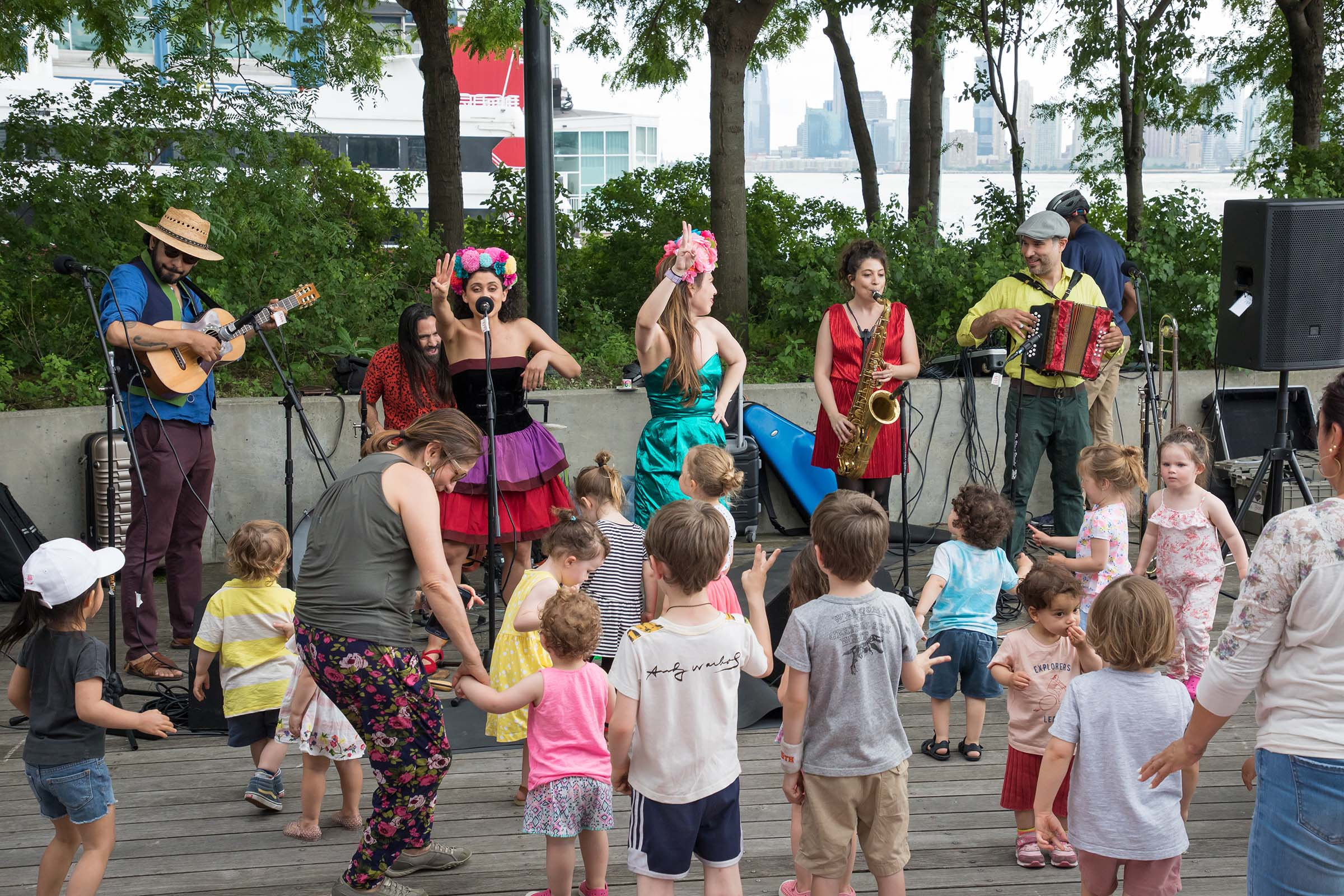 Enthralled kids enjoy the jazzy tunes at RiverKids