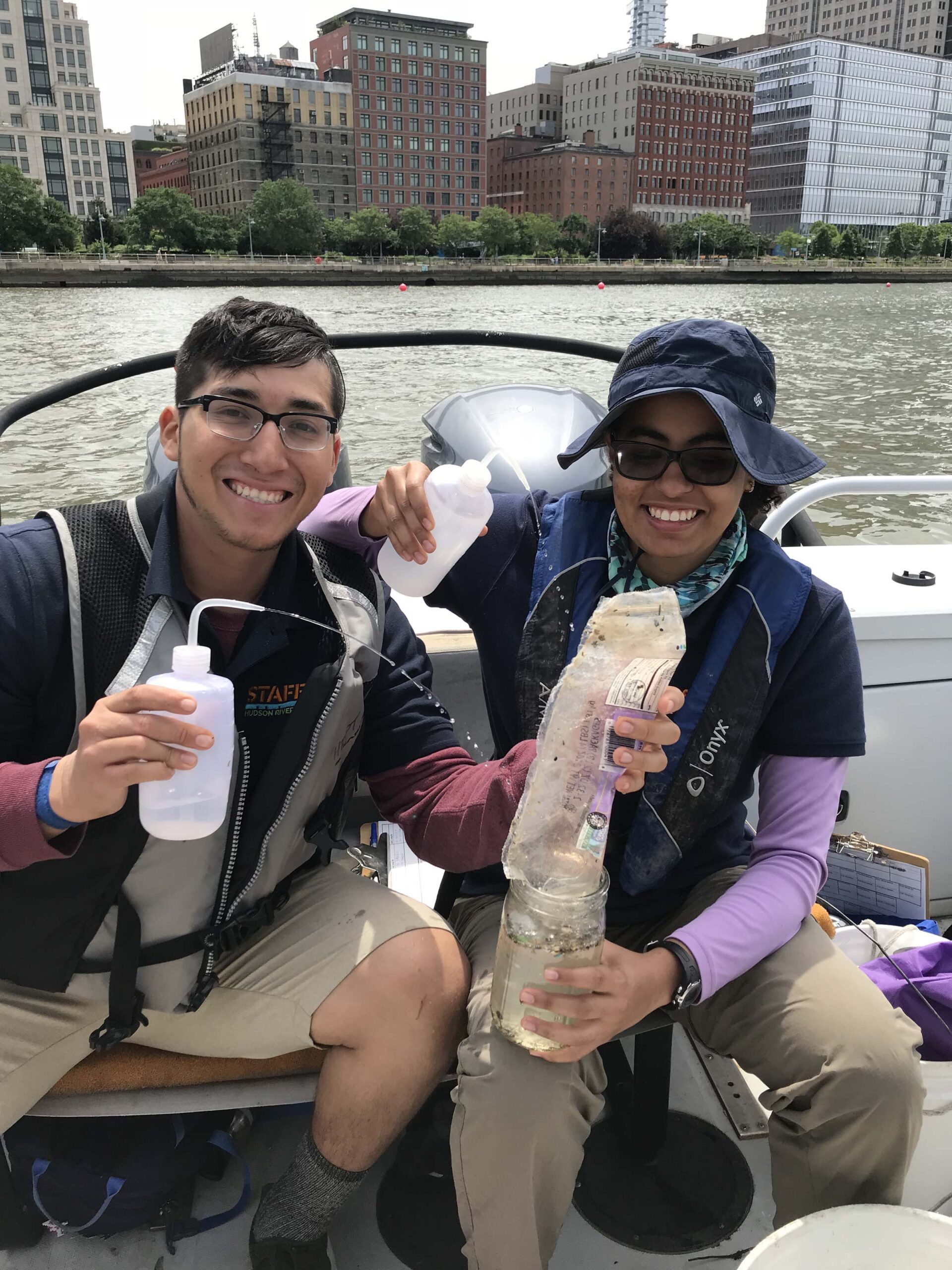 Two interns learn about the water samples