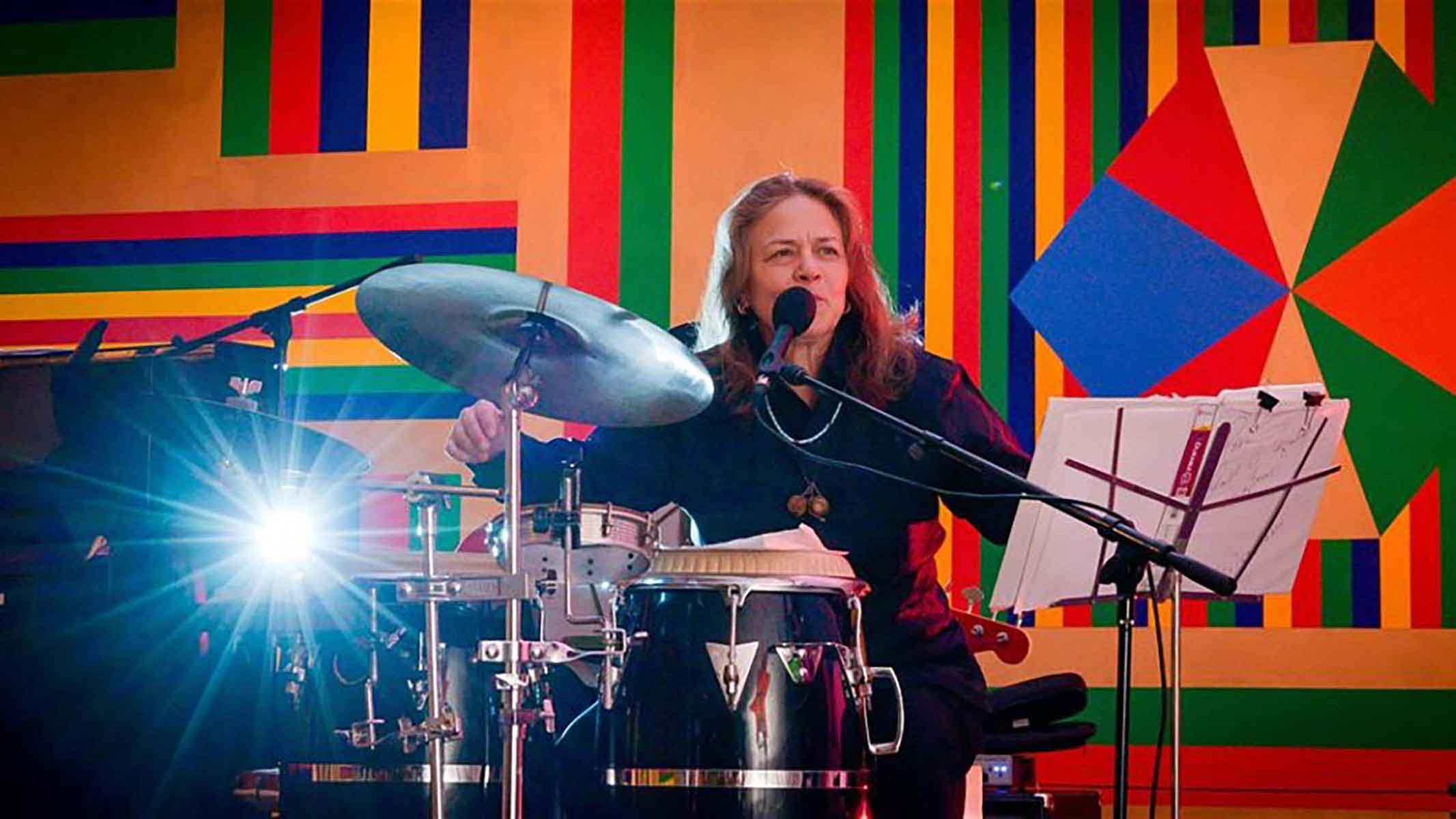 Annet A Aguilar plays the drums during a concert