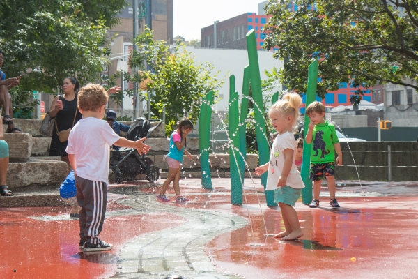 Sprinklers around the water area in Chelsea Waterside Play Area