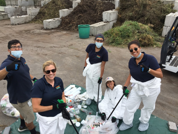 Park members of the Estuary Lab work to clear out plastics found in the Hudson River
