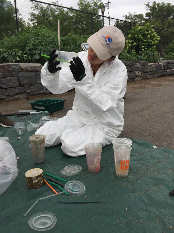 A Hudson River Park scientist examines some of the plastic found during a recent audit
