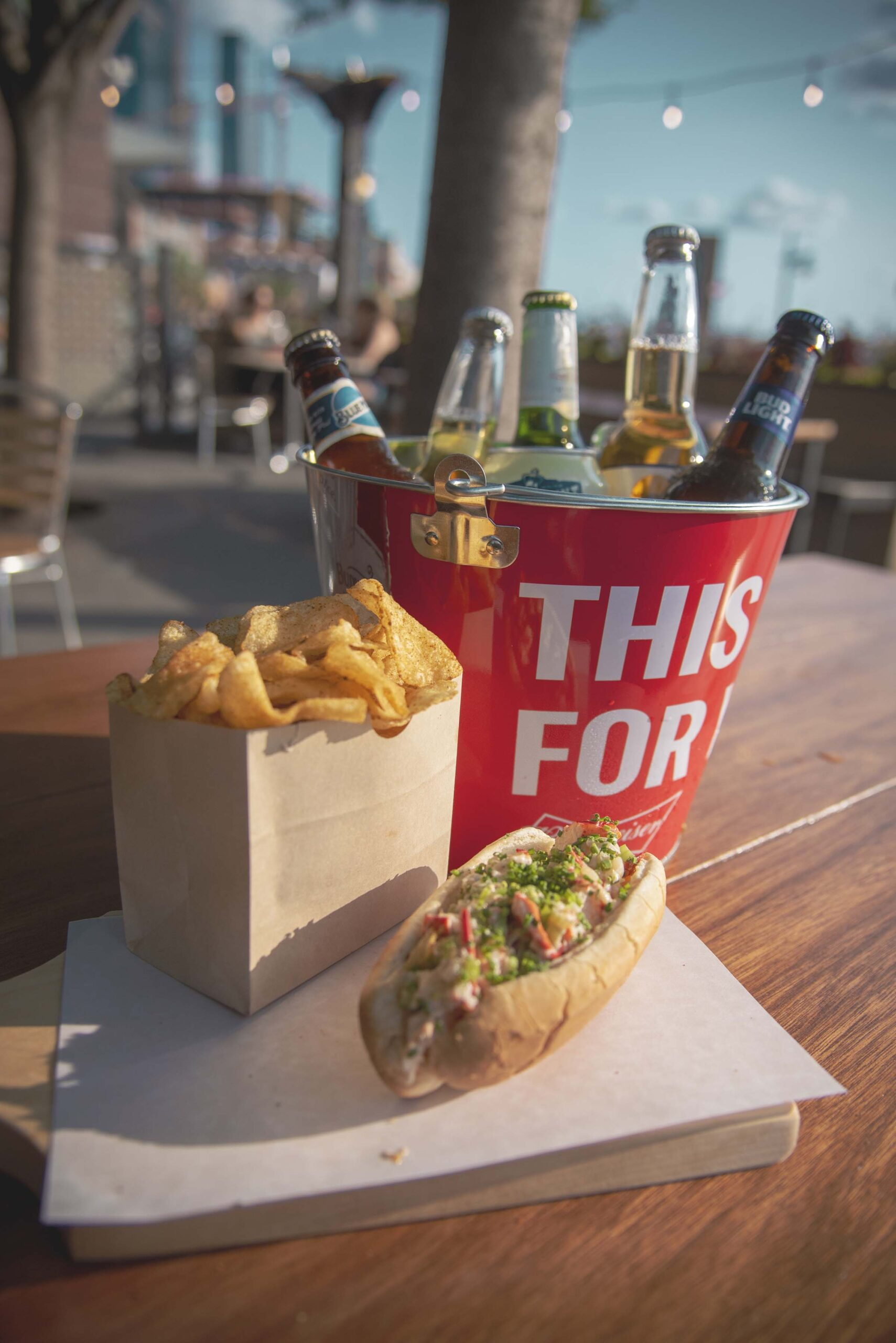 A lobster roll and a bag of chips