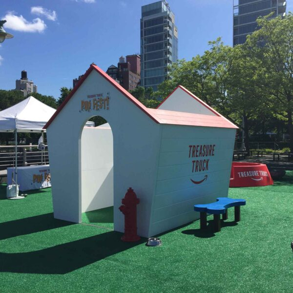 A large dog house at an event in Hudson River Park