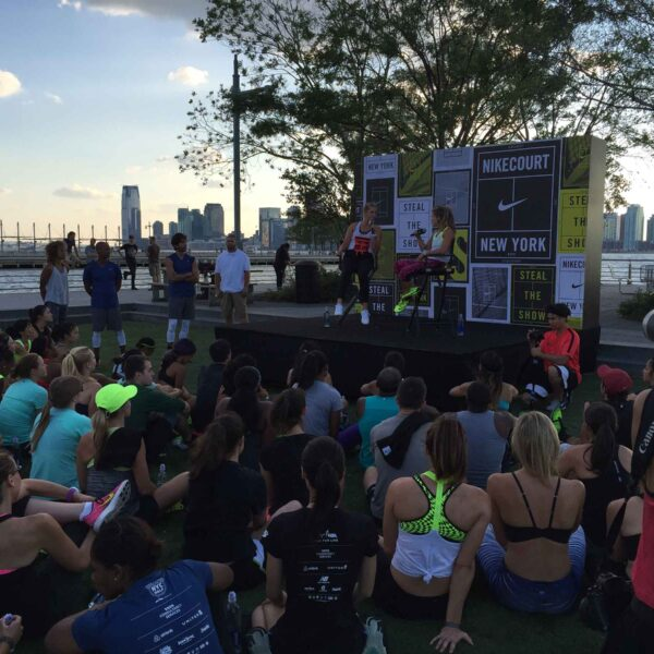 Active runners sit and listen to two women discuss running