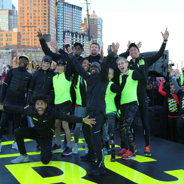 A group of runners pose for a group shot during an event in Hudson River Park