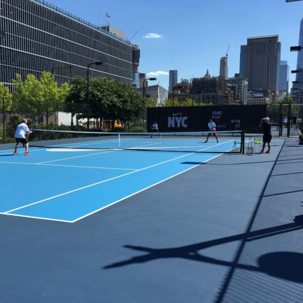 Tennis players battle it out on the courts in Hudson River Park