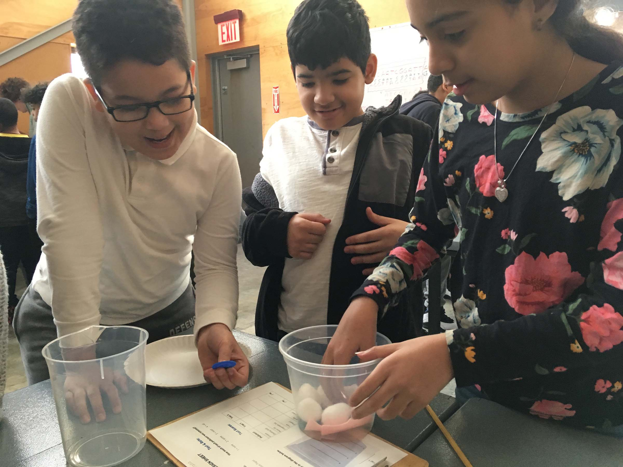 Students learn about the dangers of pollution as they go through a bucket of objects