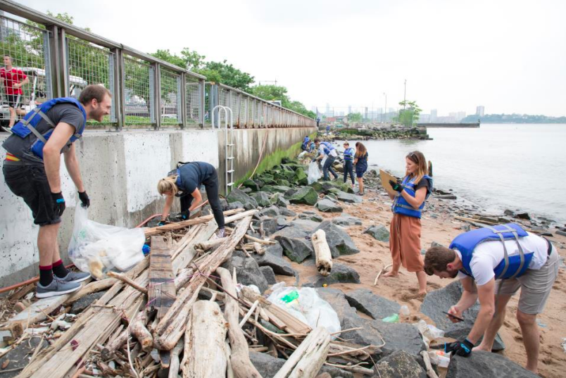 A group of volunteers clean up the plastic that was thrown on the Gansevoort Peninsula