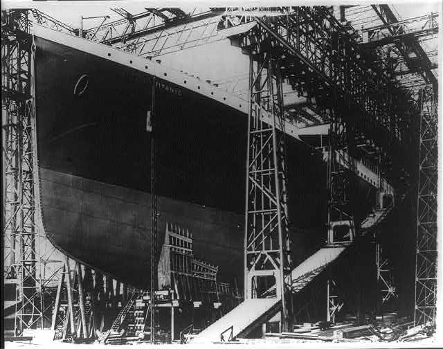 The Titanic before its voyage being prepped with cargo