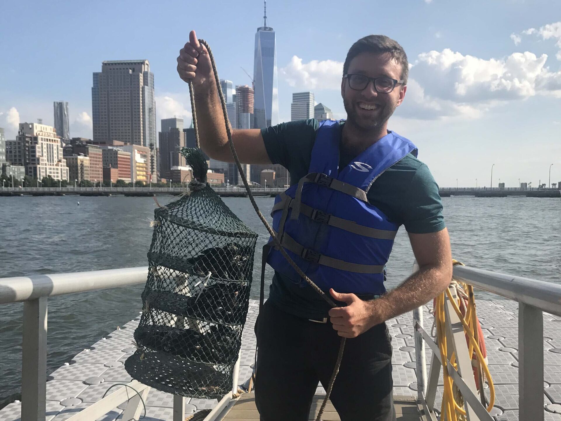 A visiting scientist shows the lobster traps