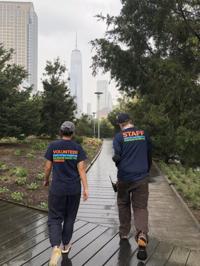 Volunteer and Staff members walk down a path at Hudson River Park