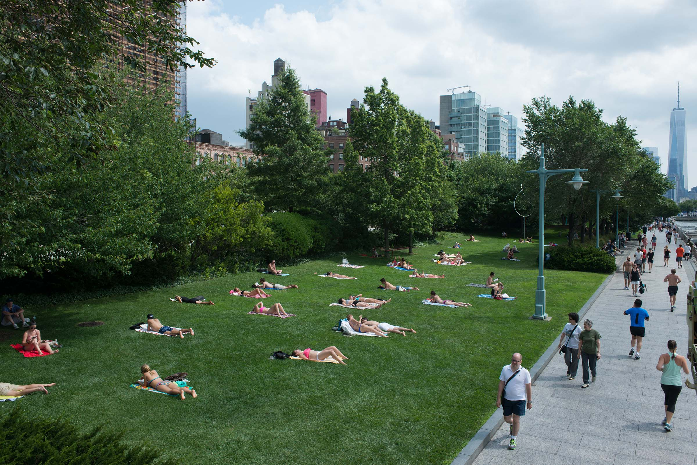 Park visitors relax on the Greenwich Village upland lawns