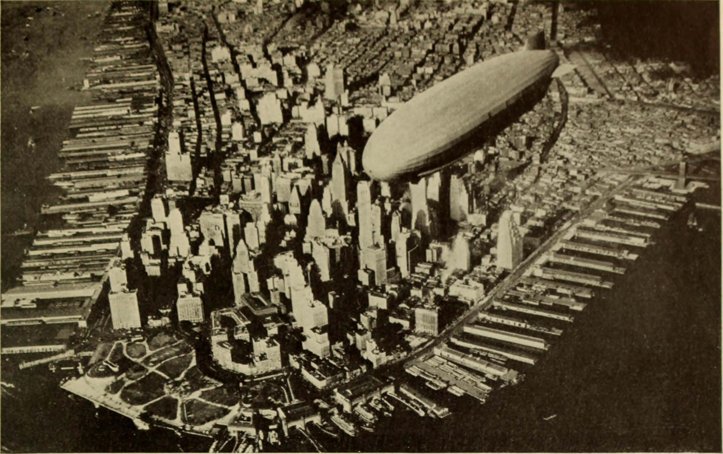 Historic image of downtown Manhattan with a blimp passing by