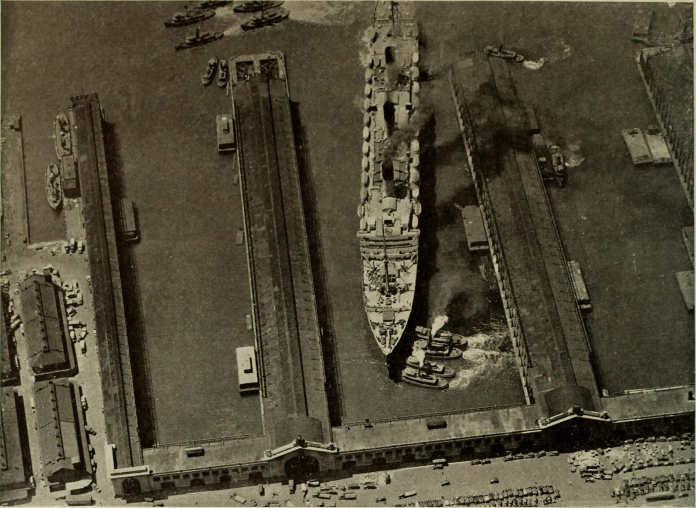 Historic image of a cruise ship pulling into the piers by the bulkhead