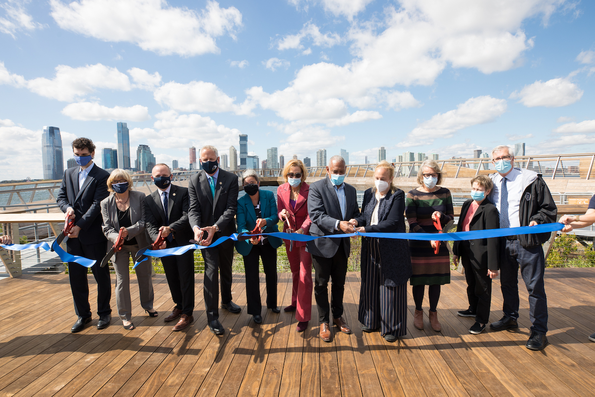 Ribbon cutting in commencement of Pier 26 opening, including members of the Hudson River Park Trust Board