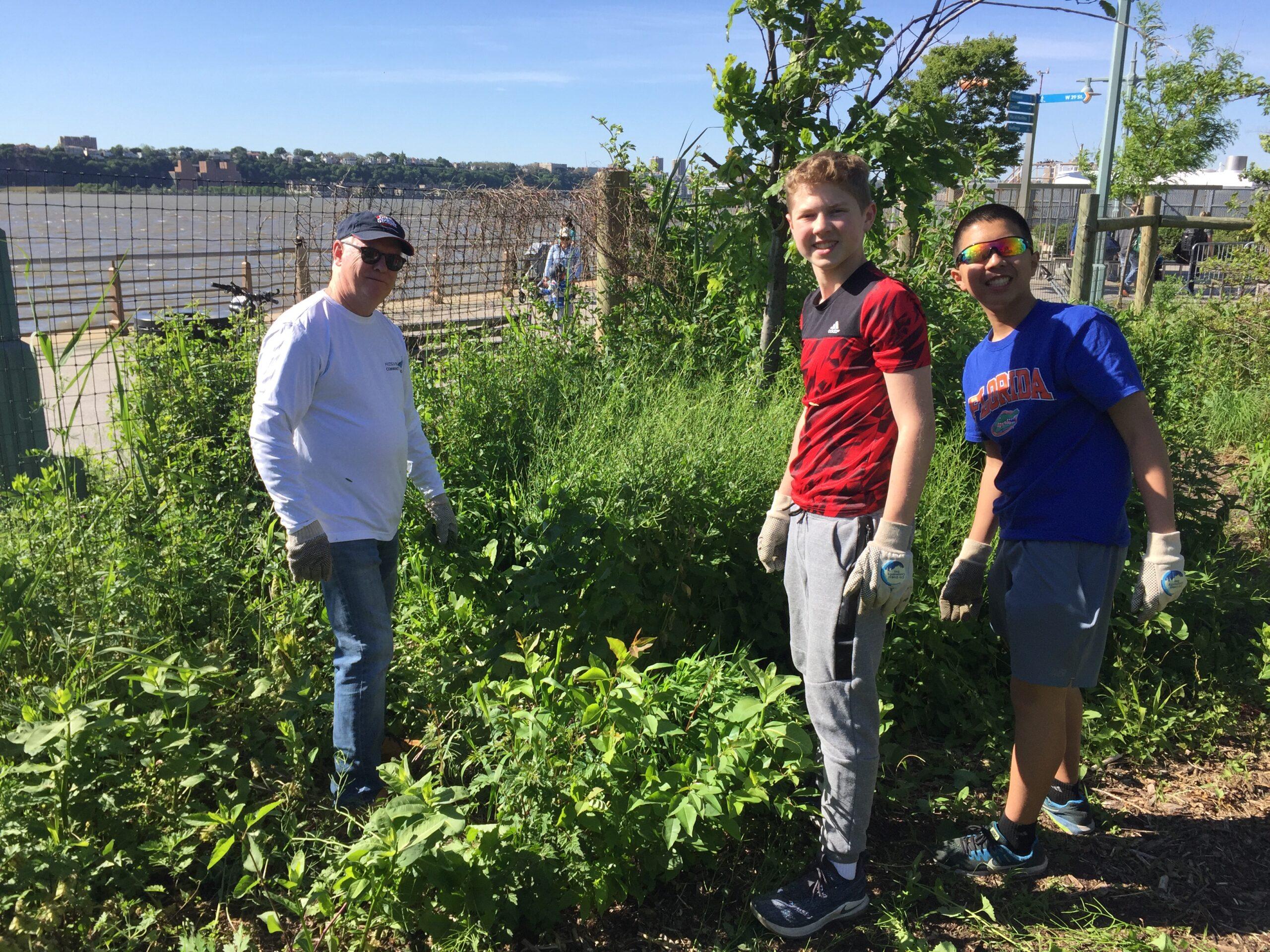 Volunteer students in the habitat garden