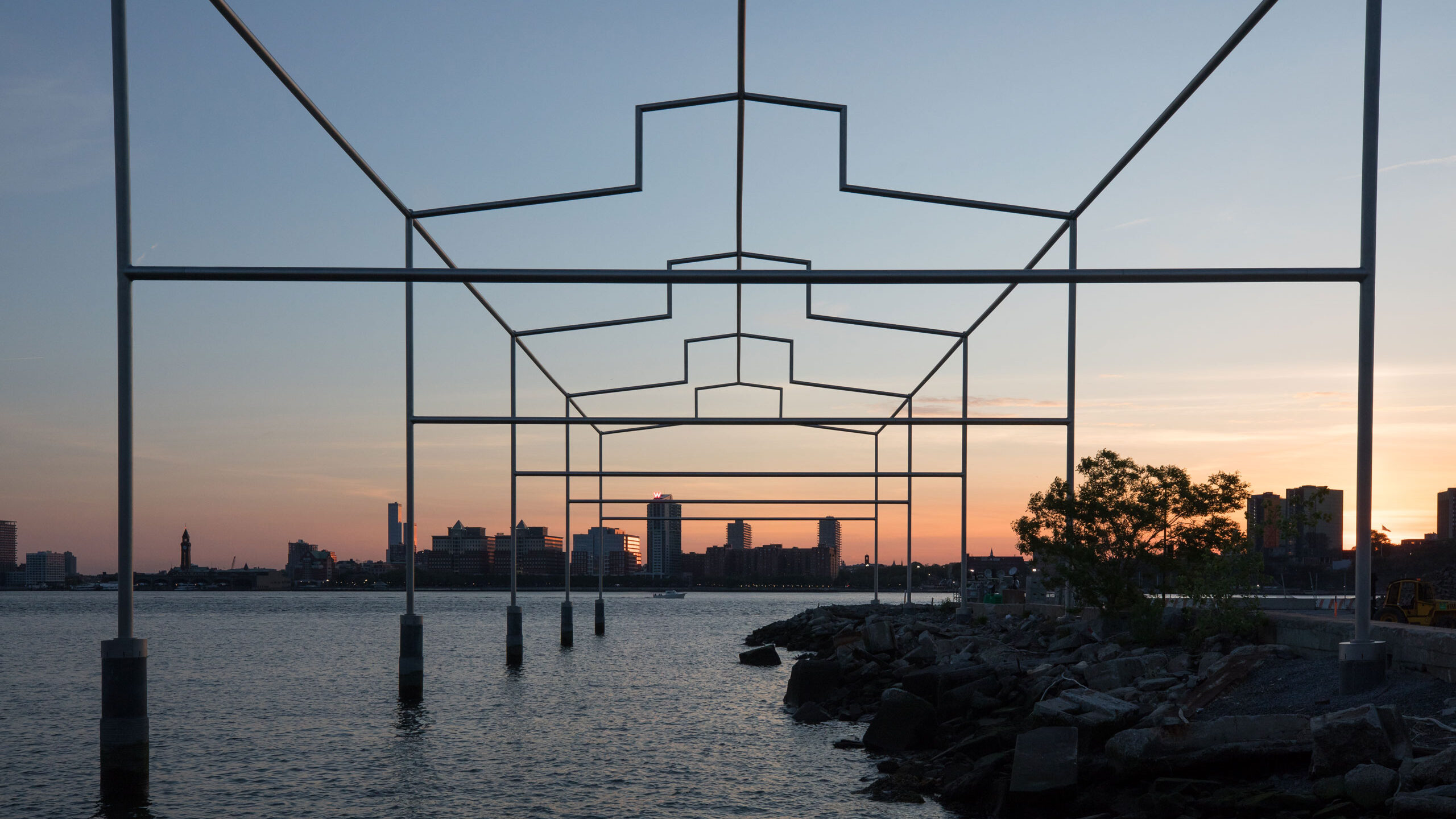Day's End by David Hammons, a gift from the Whitney Museum, sits on the Hudson River at sunset