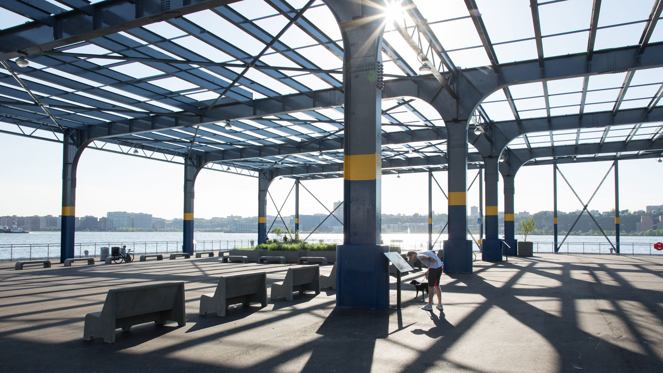 Man reads signage on the history of newly opened Pier 76 at Hudson River Park