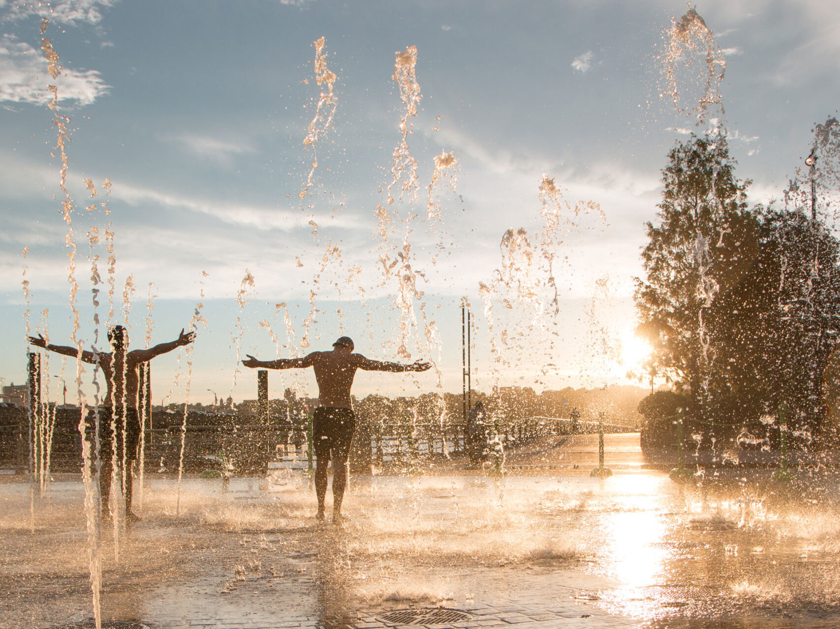 Two Park visitors enjoying the fountain area on Pier 84 at Hudson River Park