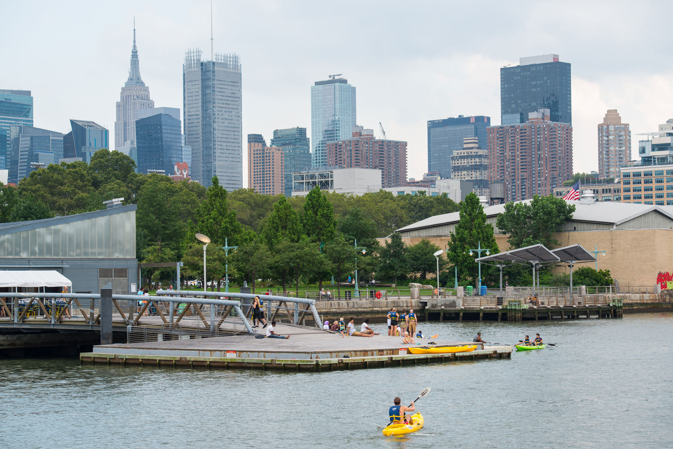 Kayakers head off into the water from the Pier 96 Boathouse at Hudson River Park