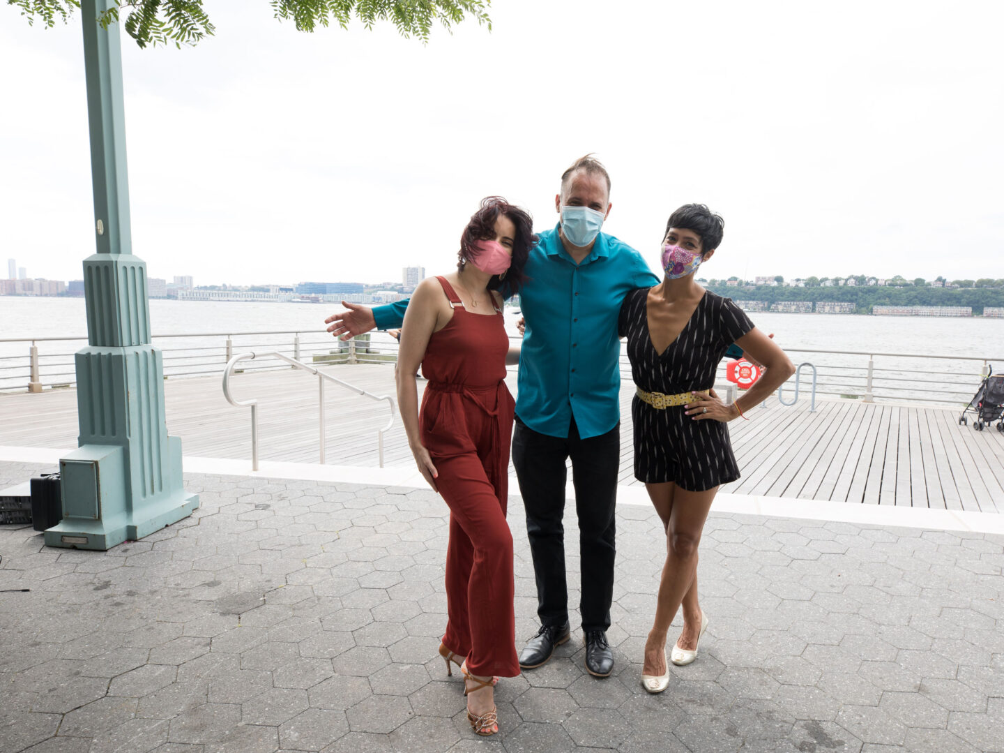 Talia Castro-Pozo and dancers gather for a photo before kicking off Sunset Salsa at Hudson River Park